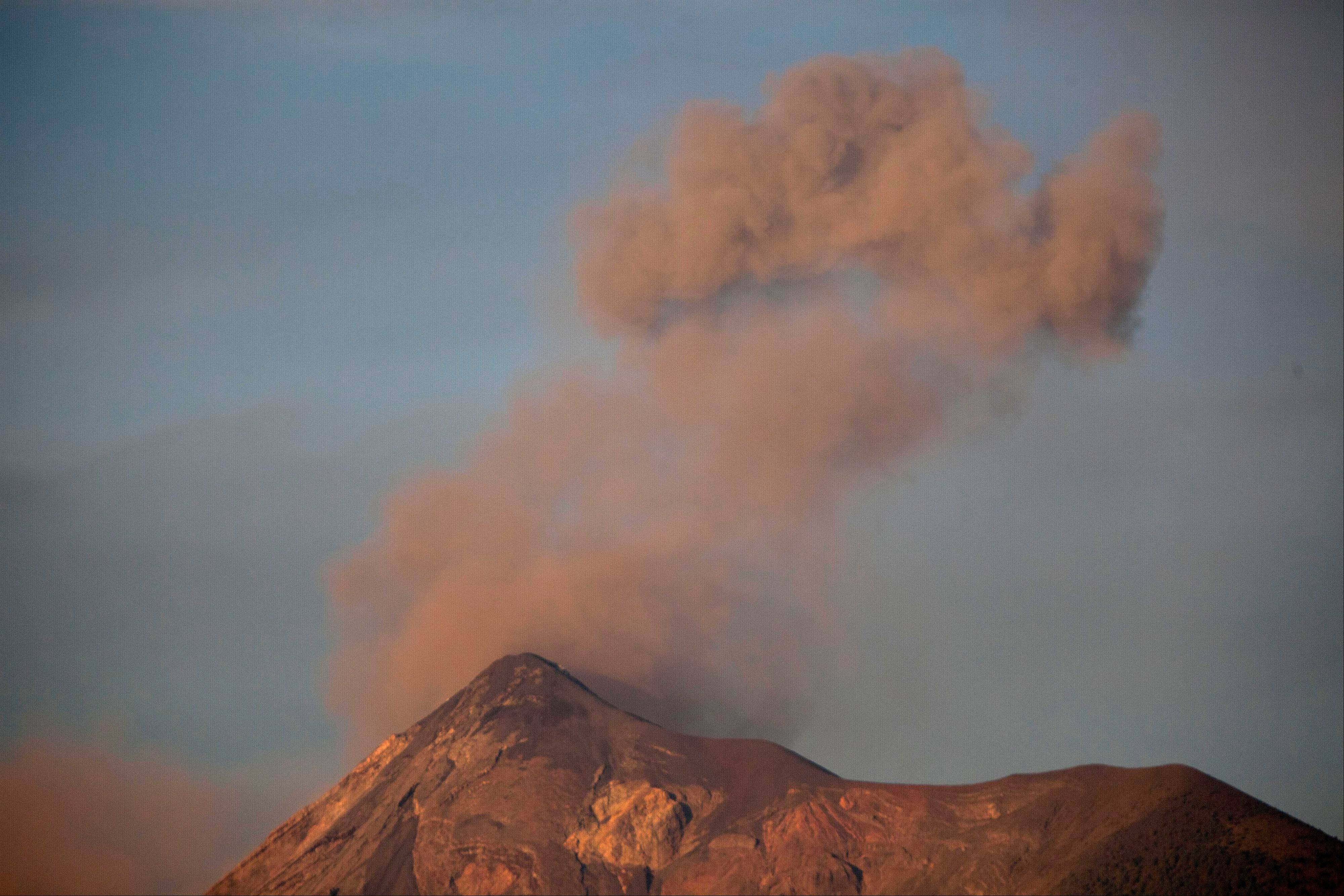 Volcan de Fuego or Volcano of Fire blows outs a thick cloud of ash as seen from Antigua Guatemala, Friday, Sept. 14, 2012. The volcano spewed rivers of bright orange lava down its flanks on Thursday. Authorities ordered more than 33,000 people from nearby communities evacuated.