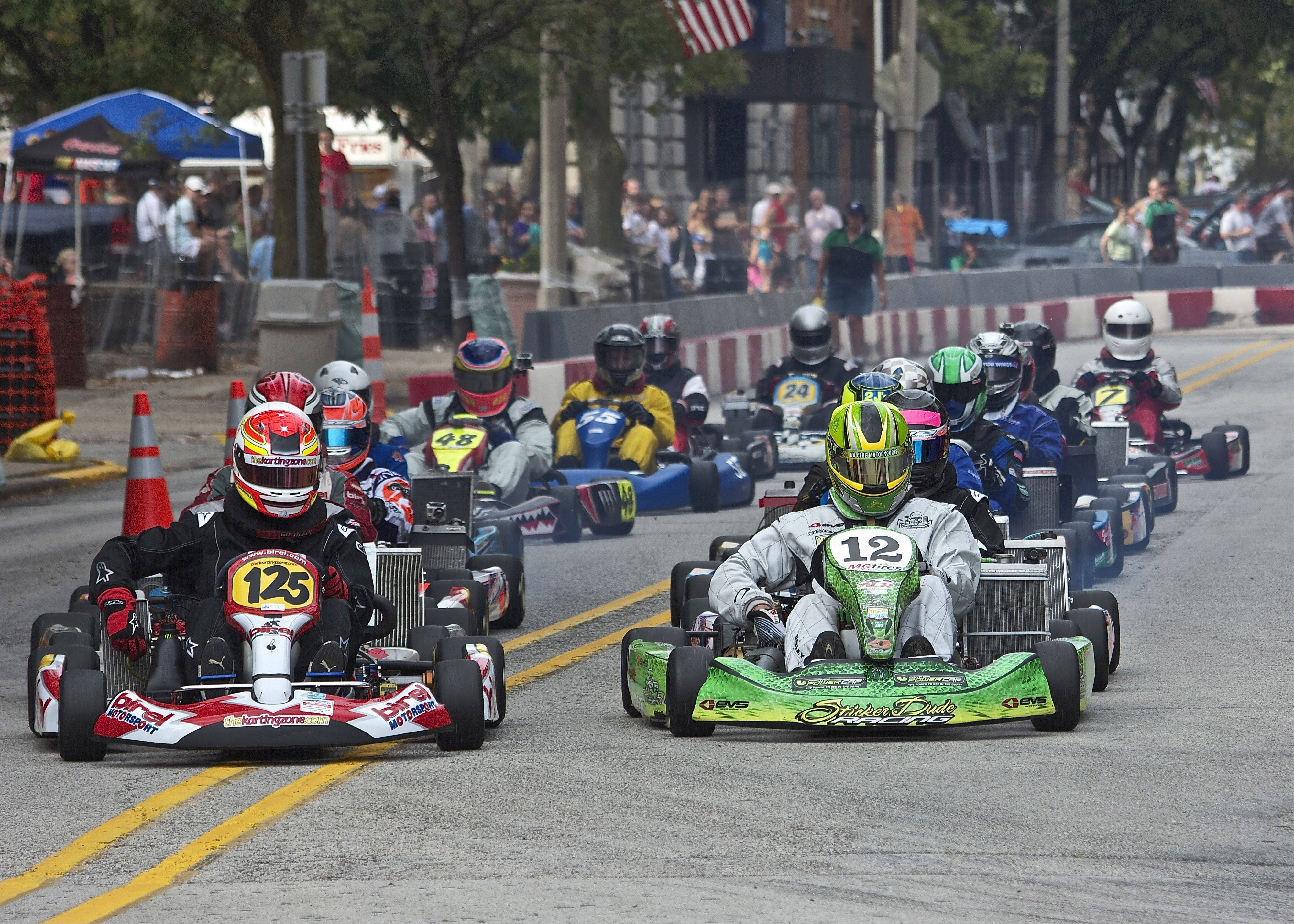 Matt Sriver, of Carpentersville, leads the field to the green flag in the TAG Masters class at the Rock Island Grand Prix during a recent Sunday. The Rock Island Grand Prix is in it's 15 year and is a street race that draws karters from all over the country and several countries.