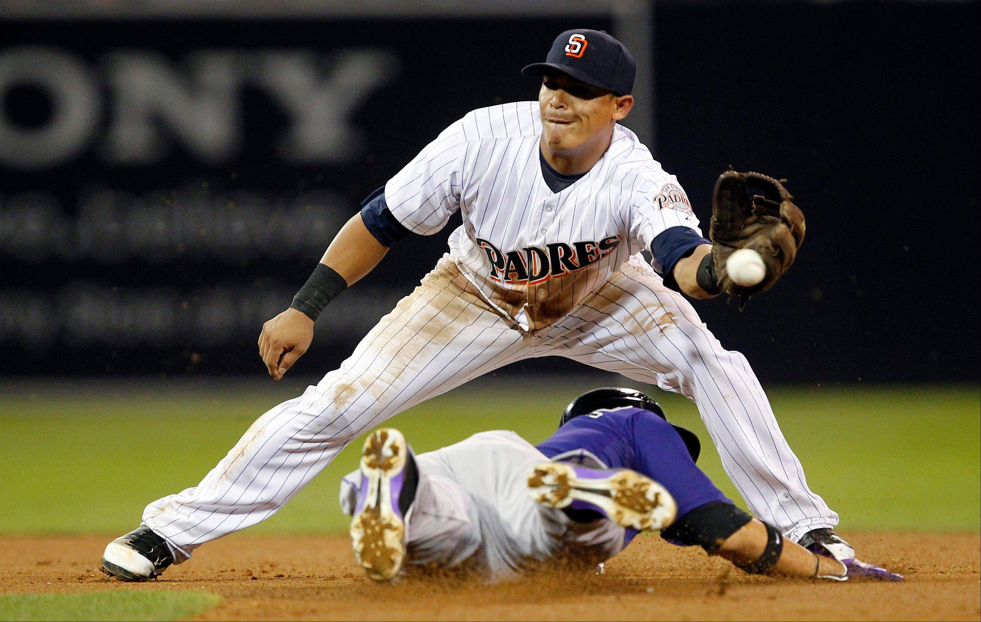 Padres shortstop Everth Cabrera can't handle the throw as the Rockies' Carlos Gonzalez steals second base during the seventh inning Friday in San Diego.