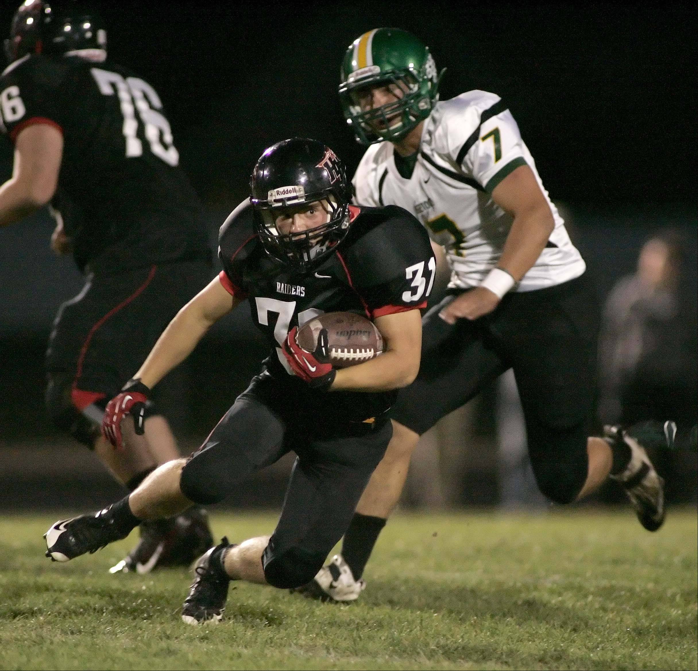 Huntley's Jake Scalise moves past Crystal Lake South's Brendan Chrystal .