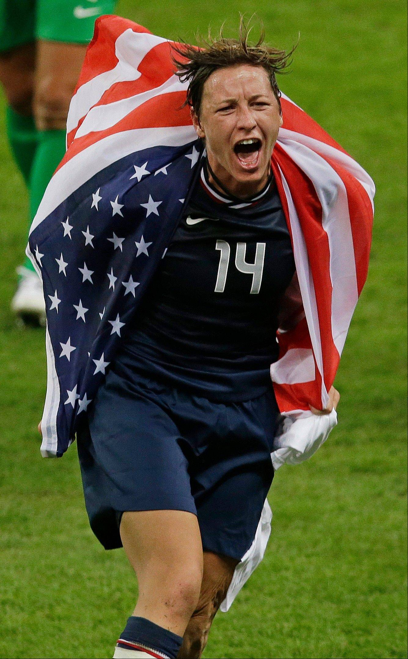 United States' Abby Wambach celebrates after winning the women's soccer gold medal match against Japan at the 2012 Summer Olympics, Thursday, Aug. 9, 2012, in London. (AP Photo/Andrew Medichini)