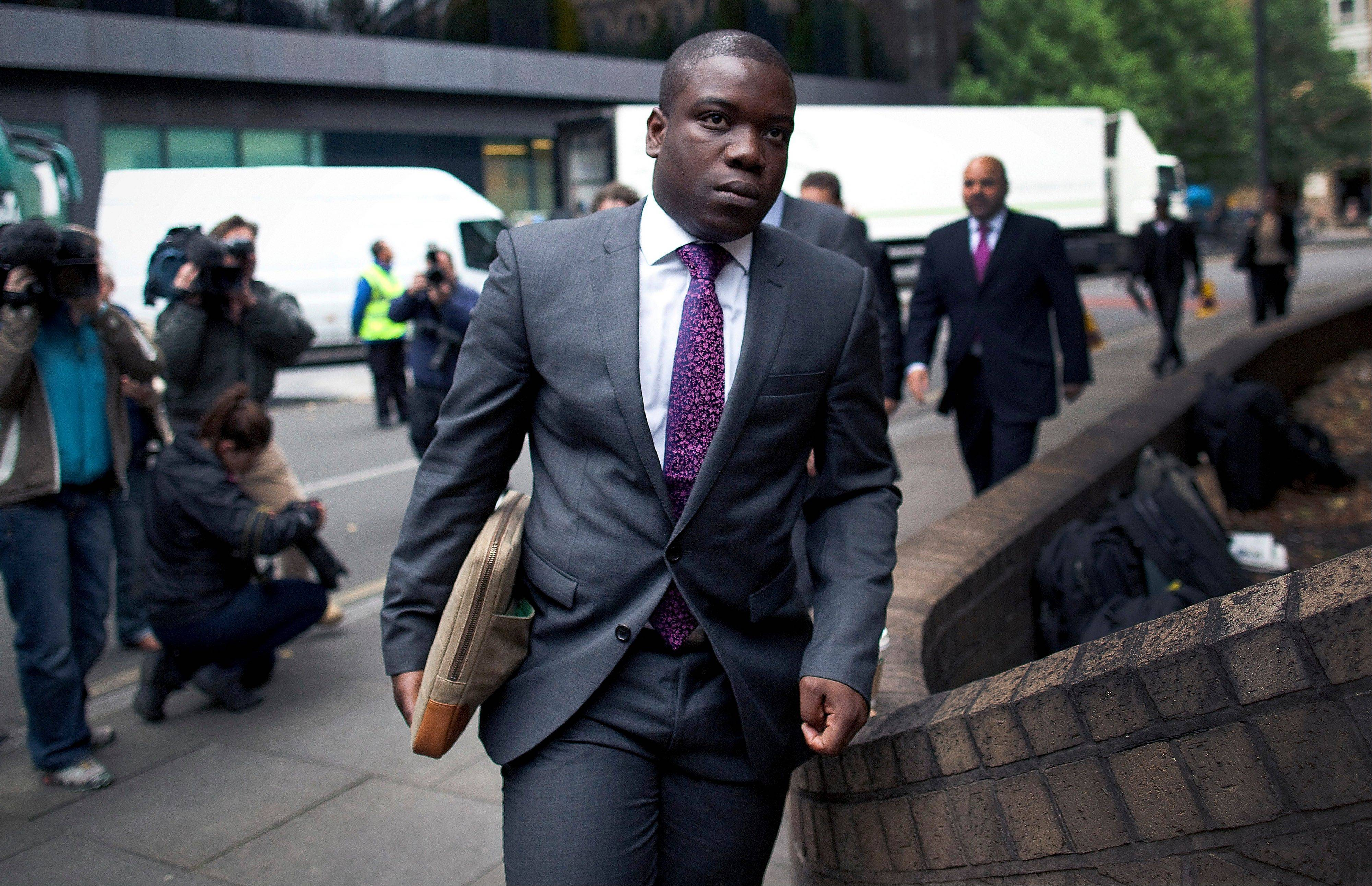Kweku Adoboli, a former trader at UBS AG, arrives at Southwark Crown Court in London, U.K., on Friday, Sept. 14, 2012. Adoboli is charged with falsifying records on exchange-traded fund transactions and other documents needed for accounting purposes as early as October 2008, according to his indictment.