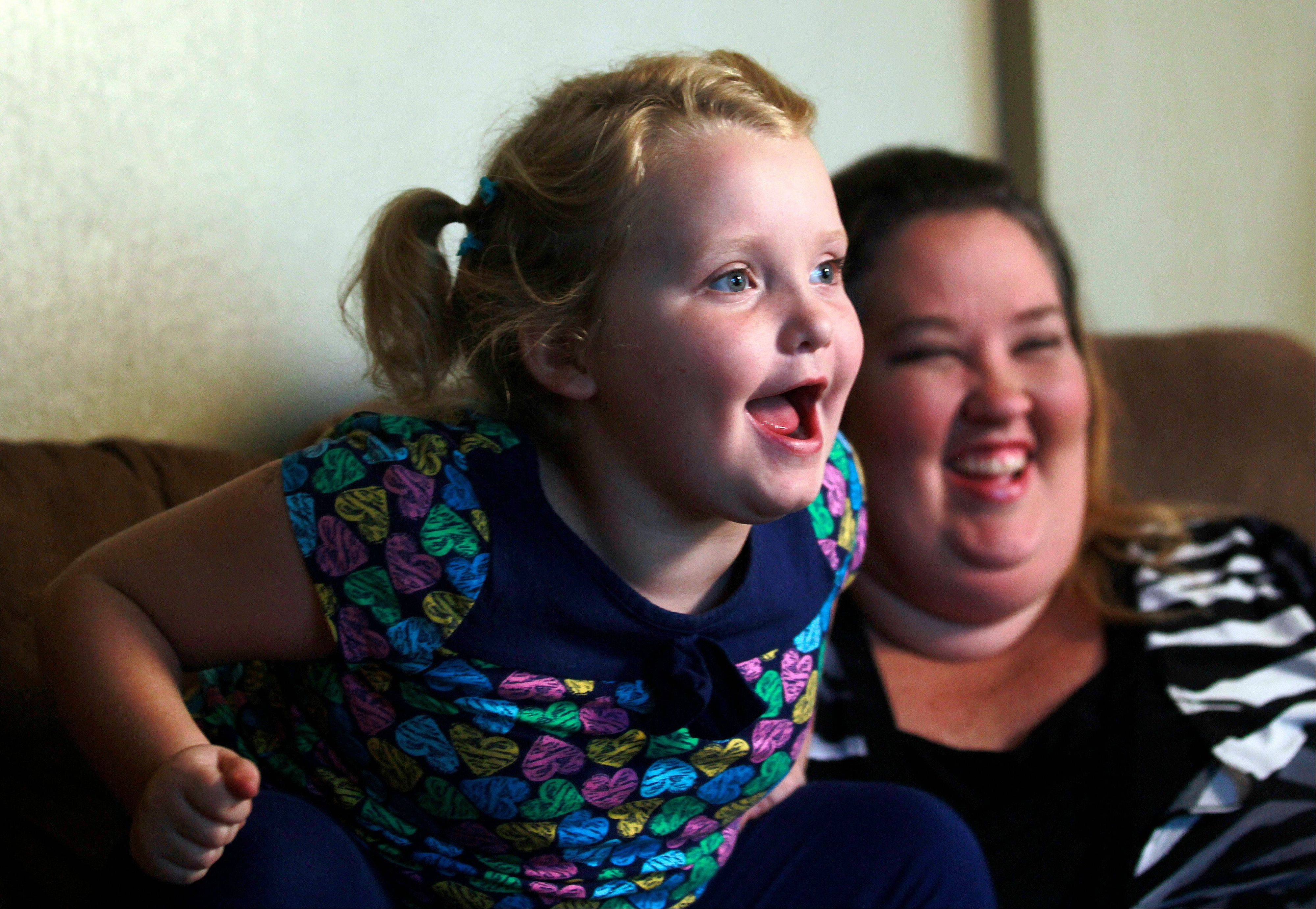 "Seven-year-old beauty pageant regular and reality show star Alana ""Honey Boo Boo"" Thompson speaks during an interview with her mother June Shannon in their home in McIntyre, Ga. The round-cheeked second-grader, who previously appeared on the TLC show ""Toddlers & Tiaras,"" has a penchant for outrageous catchphrases on her reality TV show, ""Here Comes Honey Boo Boo."""