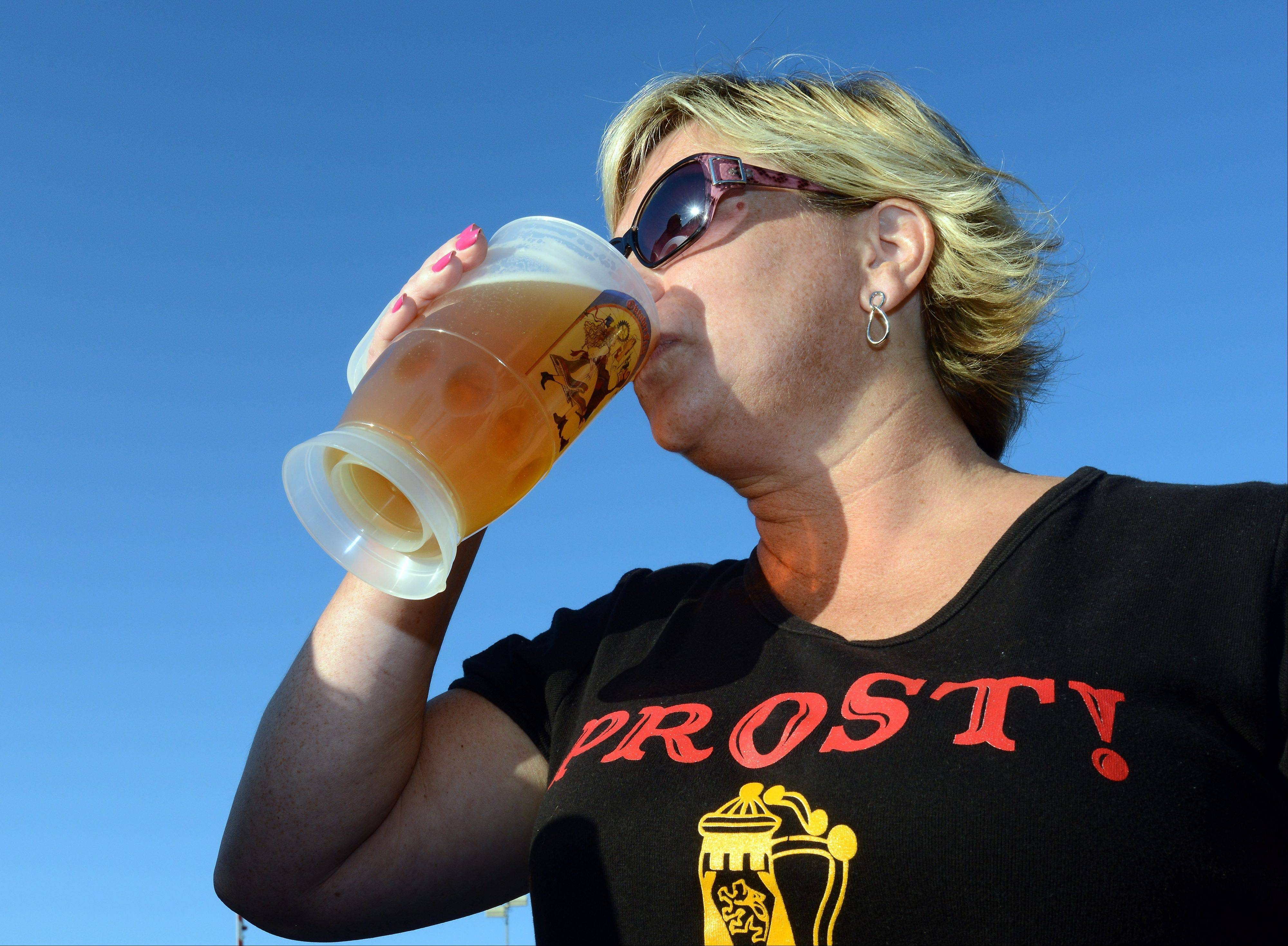 "The word on Sonya Borre's shirt is Prost, which in German means ""Cheers!"" The Palatine resident got in the spirit with tall cold beer Friday at Oktoberfest in Palatine."