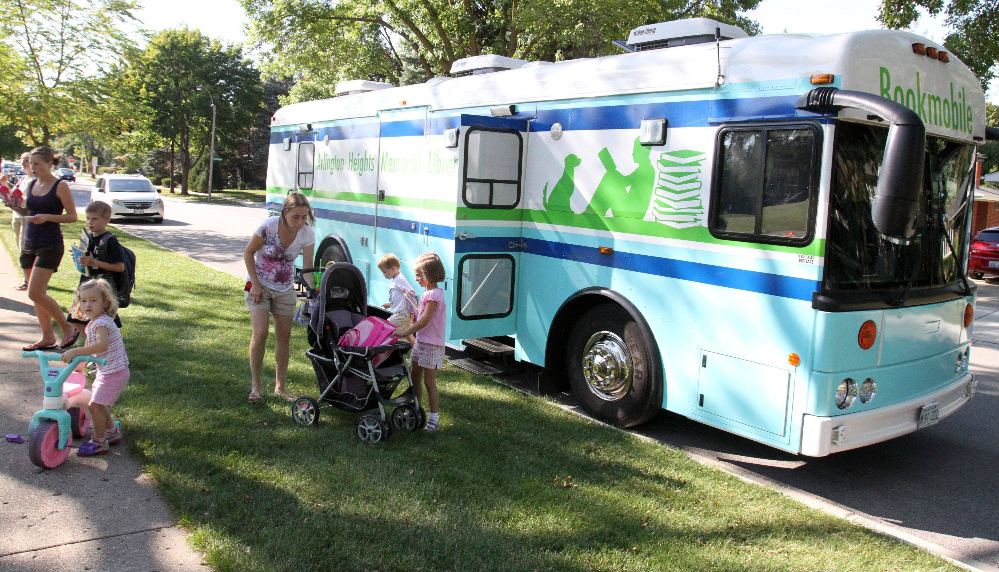 The Arlington Heights Memorial Library bookmobile is parked near Olive-Mary Stitt Elementary School in Arlington Heights in one of its 50 monthly stops.