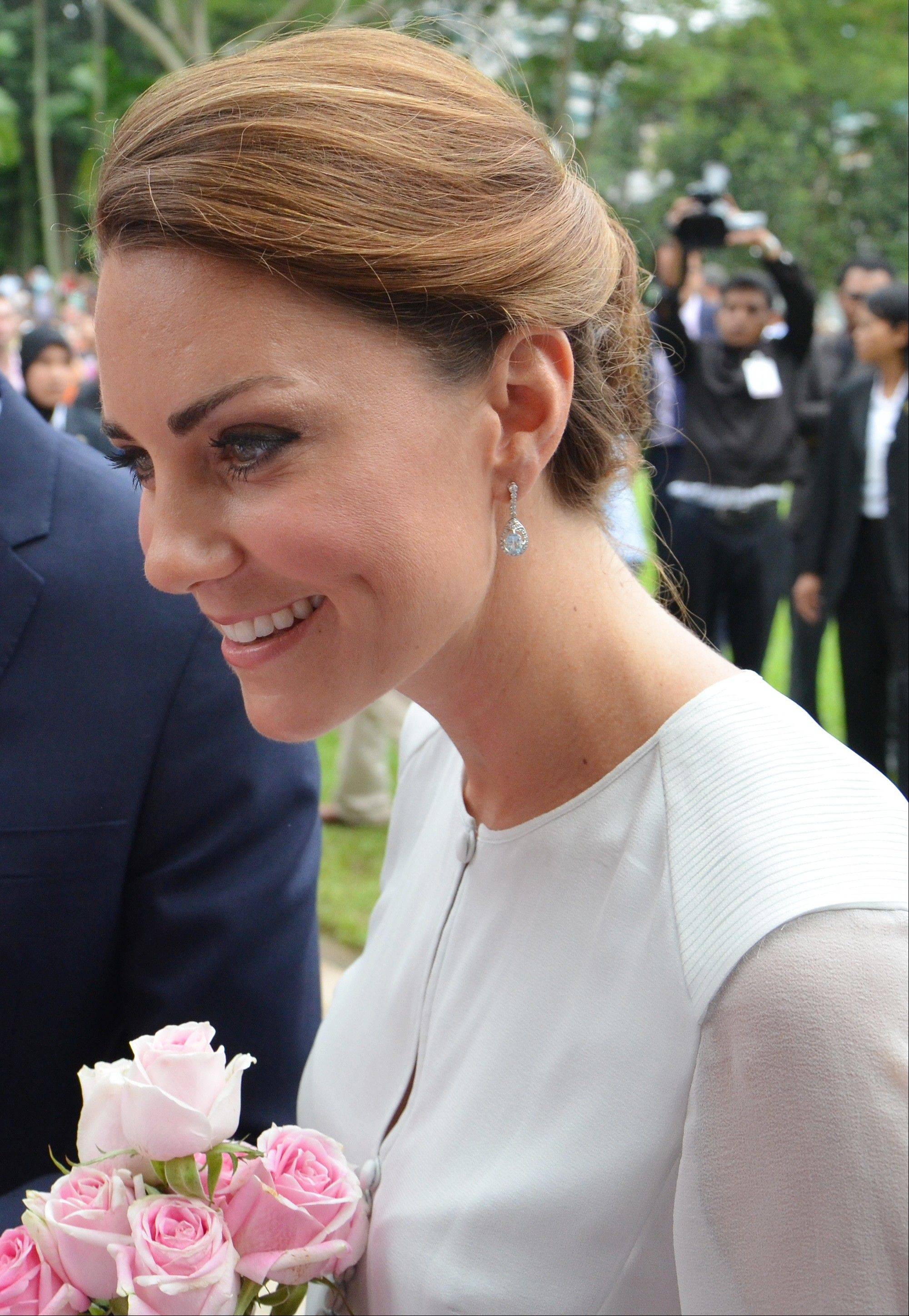 Britain's Kate, the Duchess of Cambridge talks to people in the crowd during a walk through a central city park in Kuala Lumpur, Malaysia, Friday, Sept. 14, 2012. Prince William and Kate nine are in Malaysia for a three-day visit as part of a tour to mark Queen Elizabeth II's Diamond Jubilee.