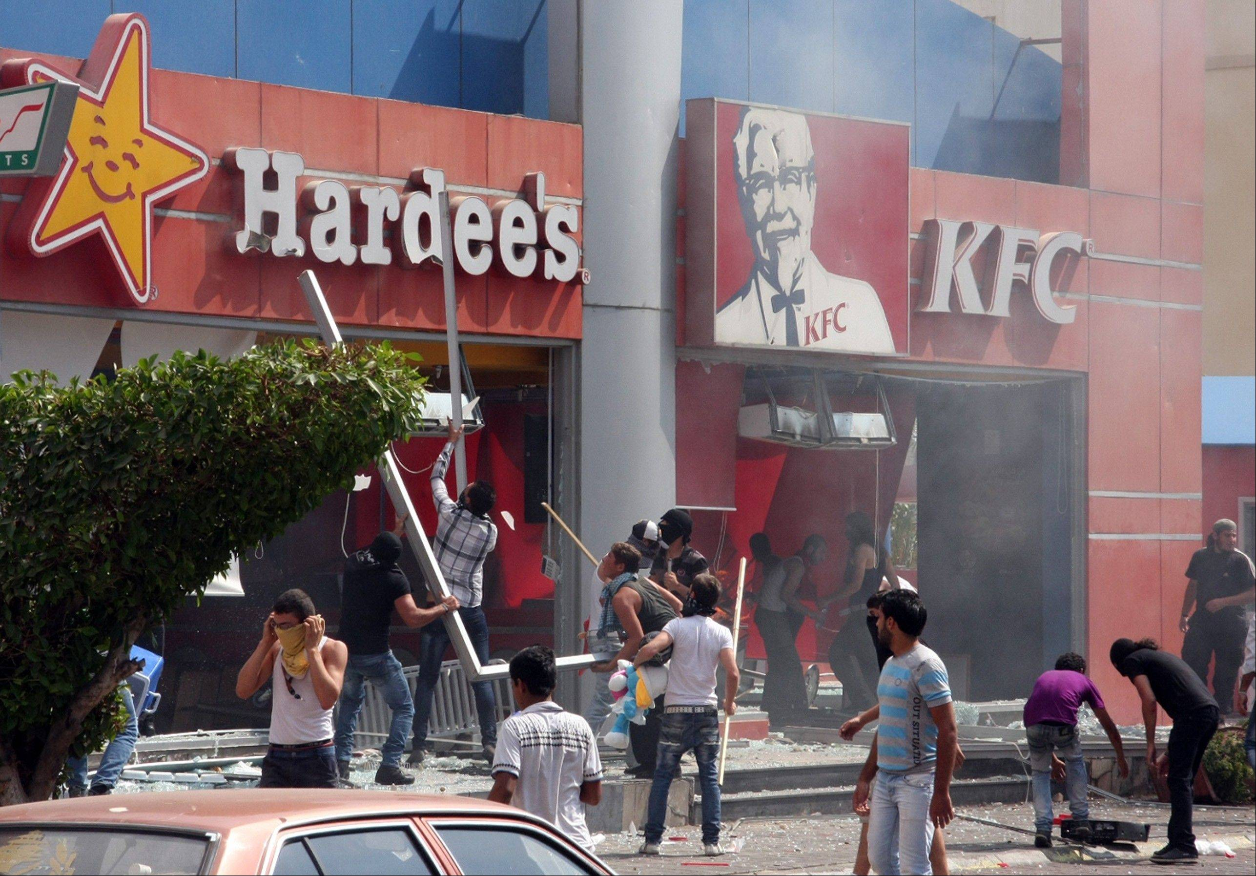 Lebanese protesters attack American fast food restaurants after Friday prayers in the northeastern city of Tripoli, Lebanon, Friday, Sept. 14, 2012. According to security officials no one was hurt in the attack which is part of widespread anger across the Muslim world about a film ridiculing Islam's Prophet Muhammad.