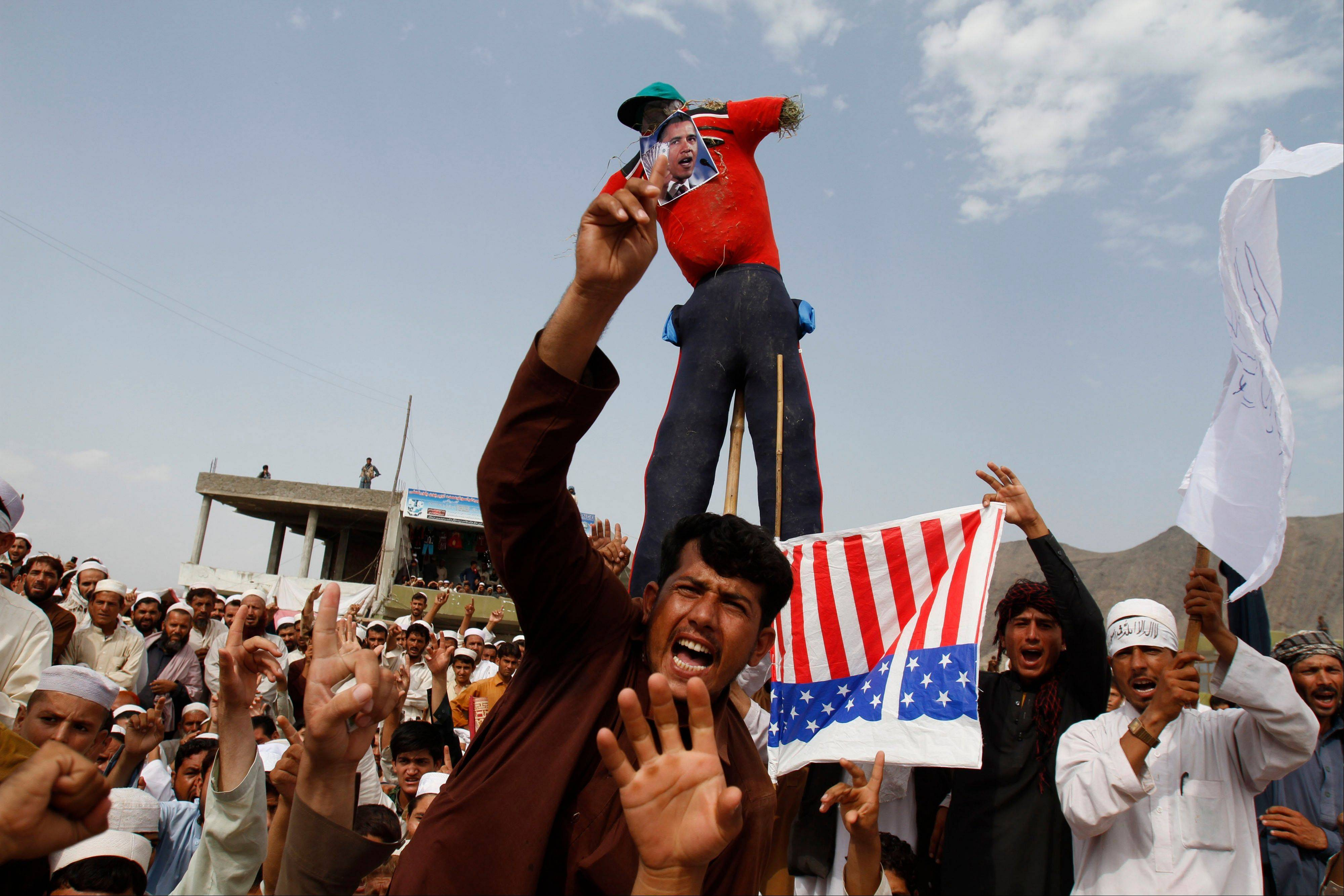 Afghans shout anti-American slogans in Ghanikhel district of Nangarhar province, east of Kabul, Afghanistan, Friday, Sept. 14, 2012 during a protest against an anti-Islam film which depicts the Prophet Muhammad as a fraud, a womanizer and a madman.