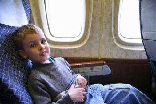 Sure, this kid looks like a sweetheart now. But after four hours cooped up on a plane, he might be bouncing off the walls.