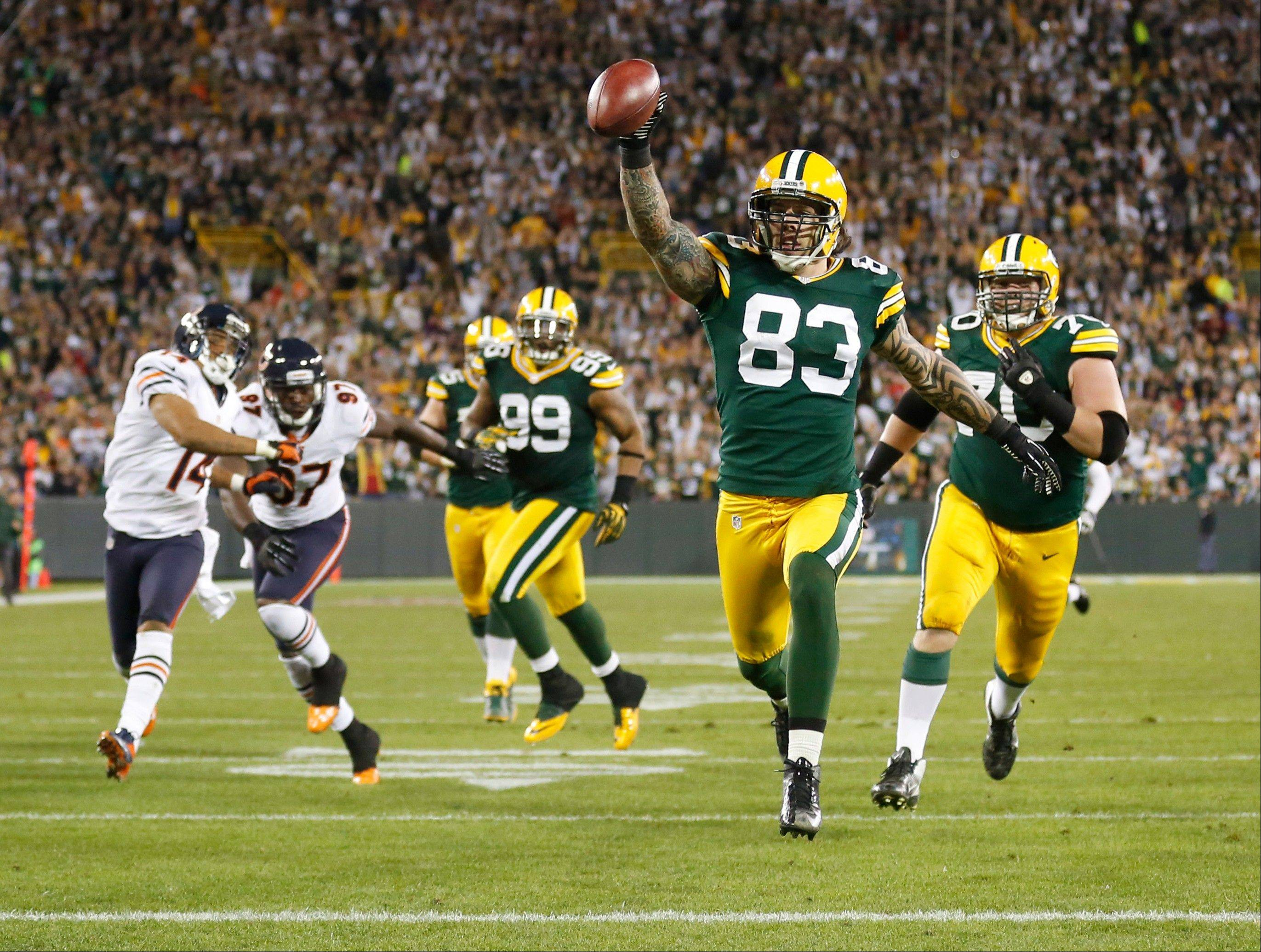 Green Bay Packers' Tom Crabtree (83) celebrates as he scores a touchdown on a pass from punter -- yes, the punter -- Tim Masthay during the first half against the Chicago Bears last night.