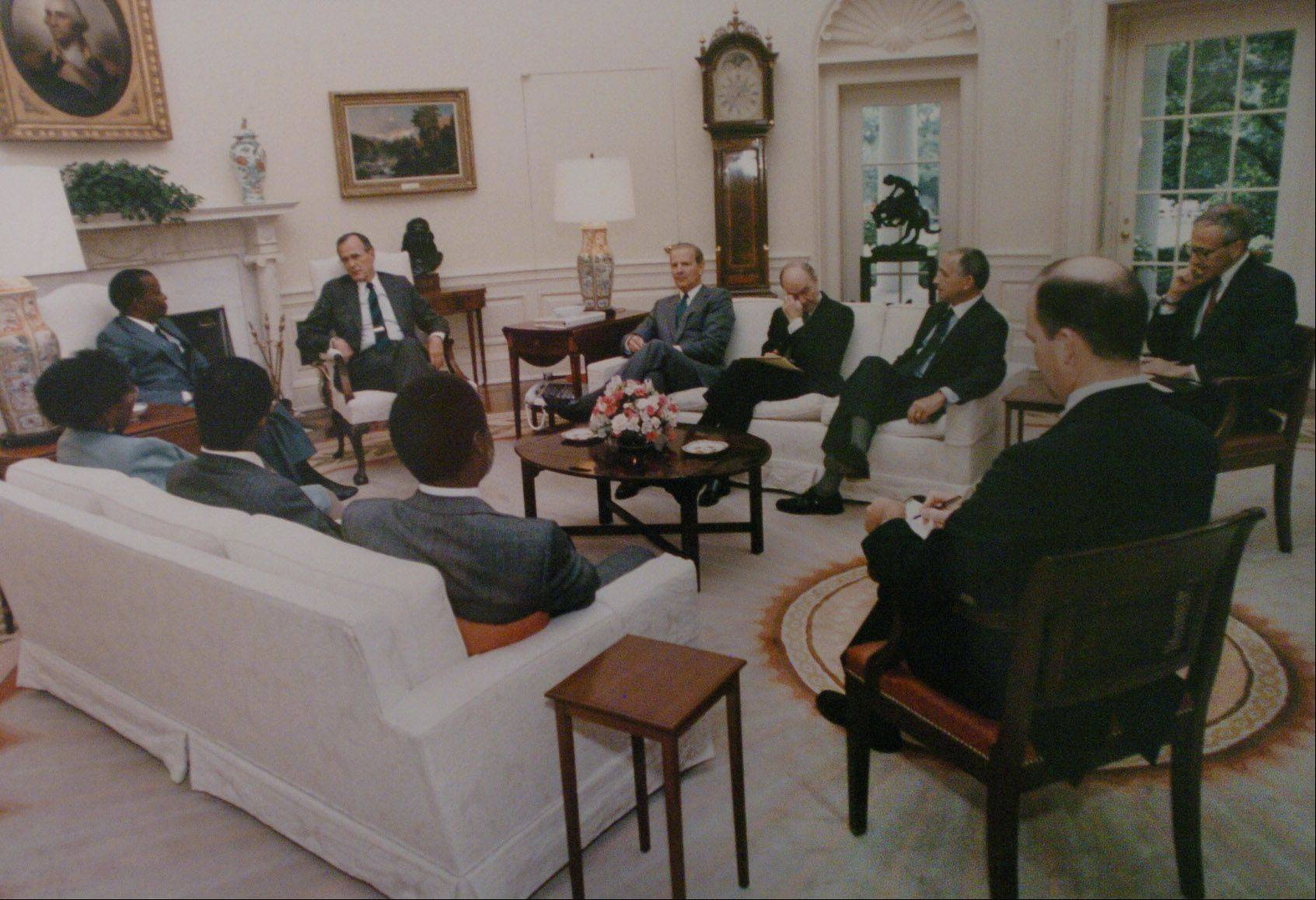 John Kordek, former U.S. Ambassador to Botswana, meets with a diplomatic delegation in the Oval Office with former President George H.W. Bush.