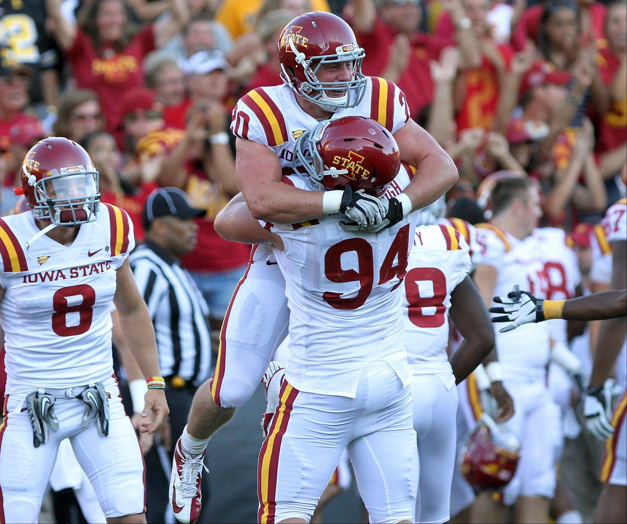 Iowa State's Jake McDonough (94) hugs Jake Knott after Knott intercepted an Iowa pass during the fourth quarter last Saturday in Iowa City. The Cyclones host Western Illinois this week.