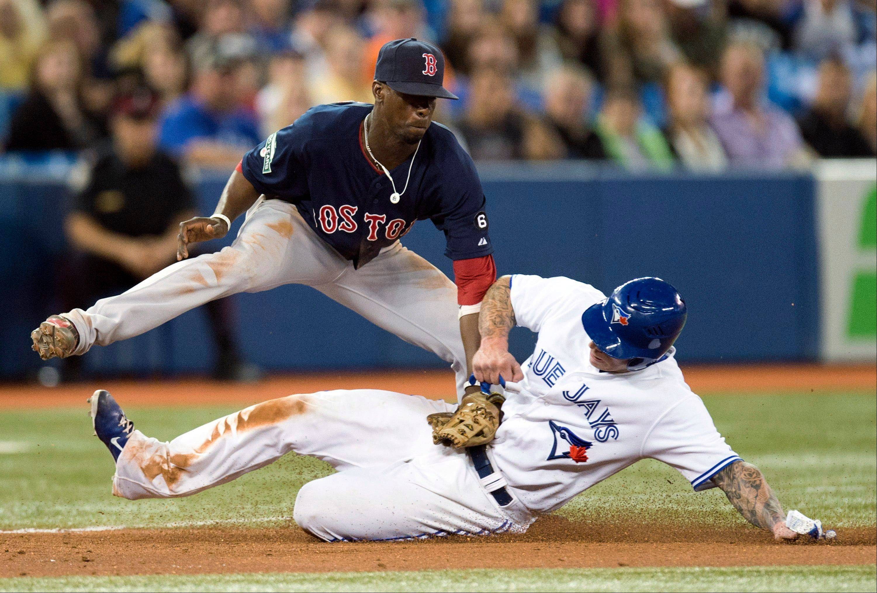 Boston Red Sox third baseman Pedro Ciriaco tags out the Blue Jays' Brett Lawrie during the eighth inning Friday in Toronto.