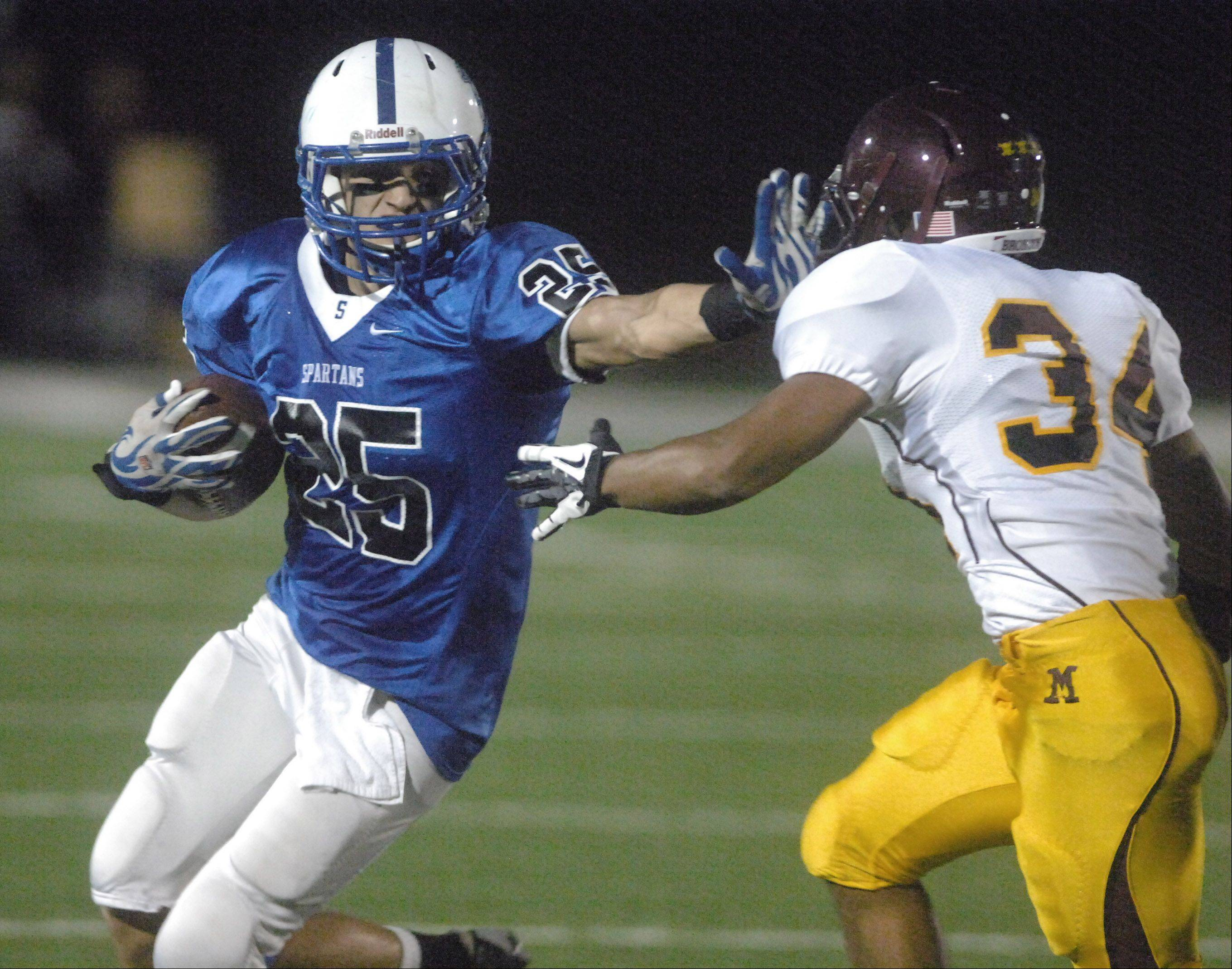 Jack Petrando of St. Francis tries to keep Josh Belt of Montini away.