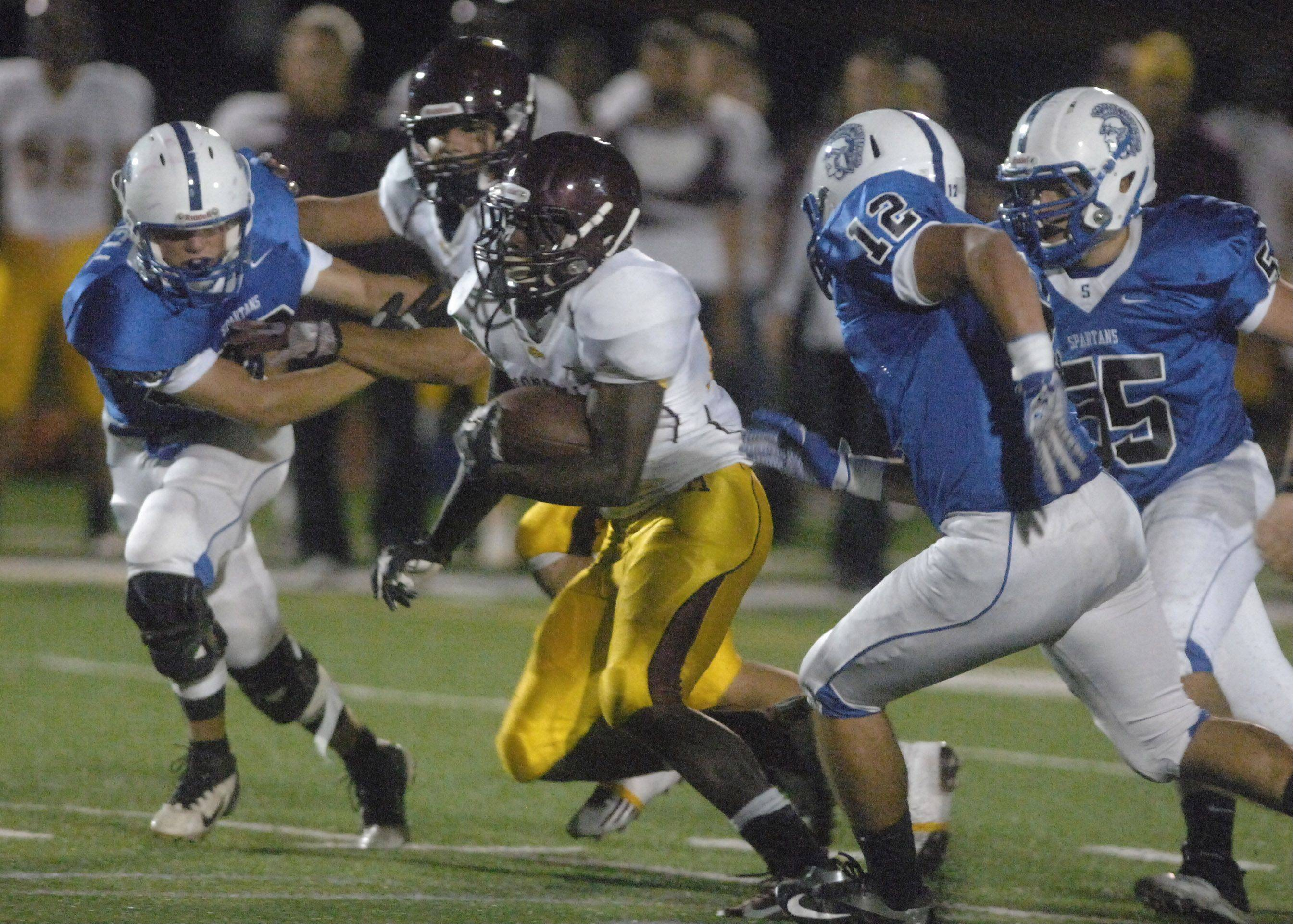 Dimitri Taylor of Montini runs with the ball.