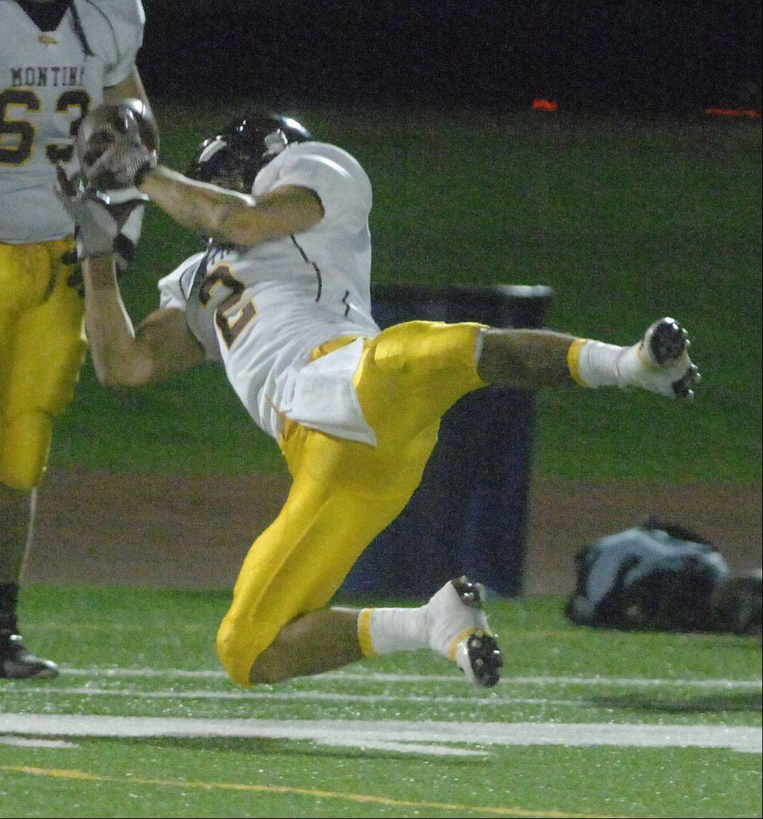 Mark Gorogianis of Montini takes a dive for the ball.