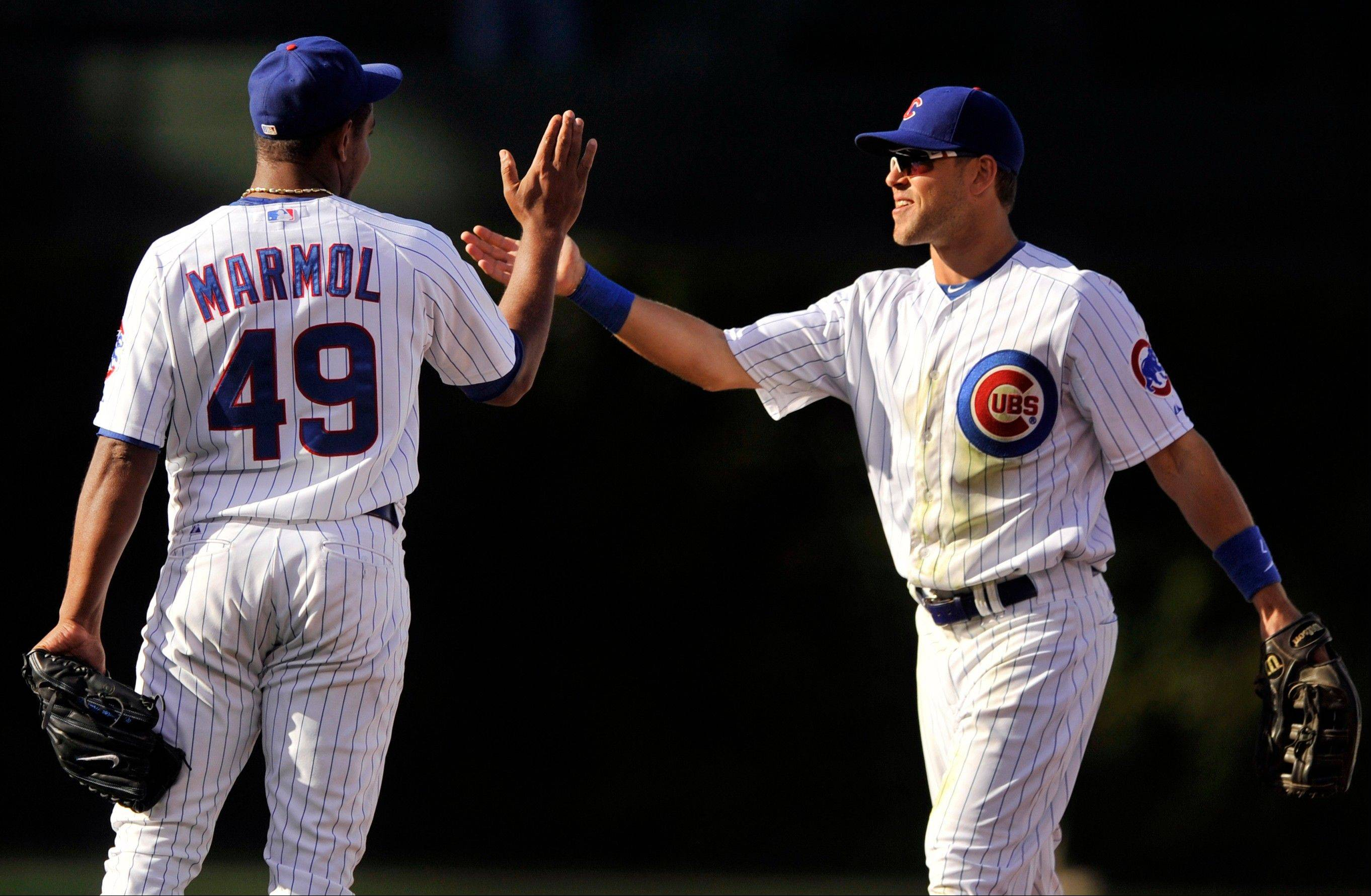 Brett Jackson, right, celebrates with Cubs closer Carlos Marmol, who recorded his 19th straight save and 20th of the season Friday in a 7-4 win over the Pirates at Wrigley Field.