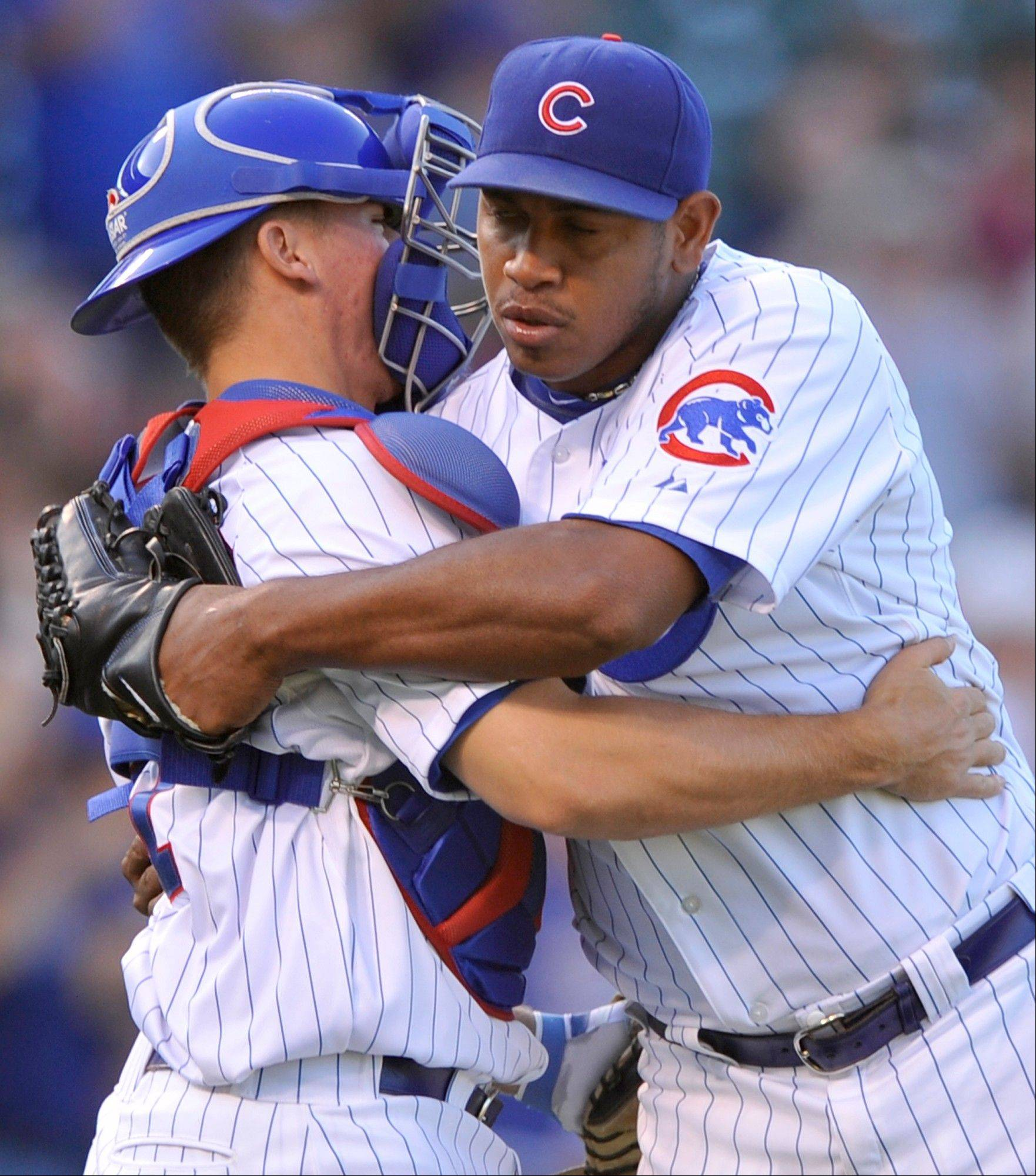Closer Carlos Marmol celebrates with catcher Steve Clevenger after the Cubs beat the Pirates 7-4 at Wrigley Field on Friday.