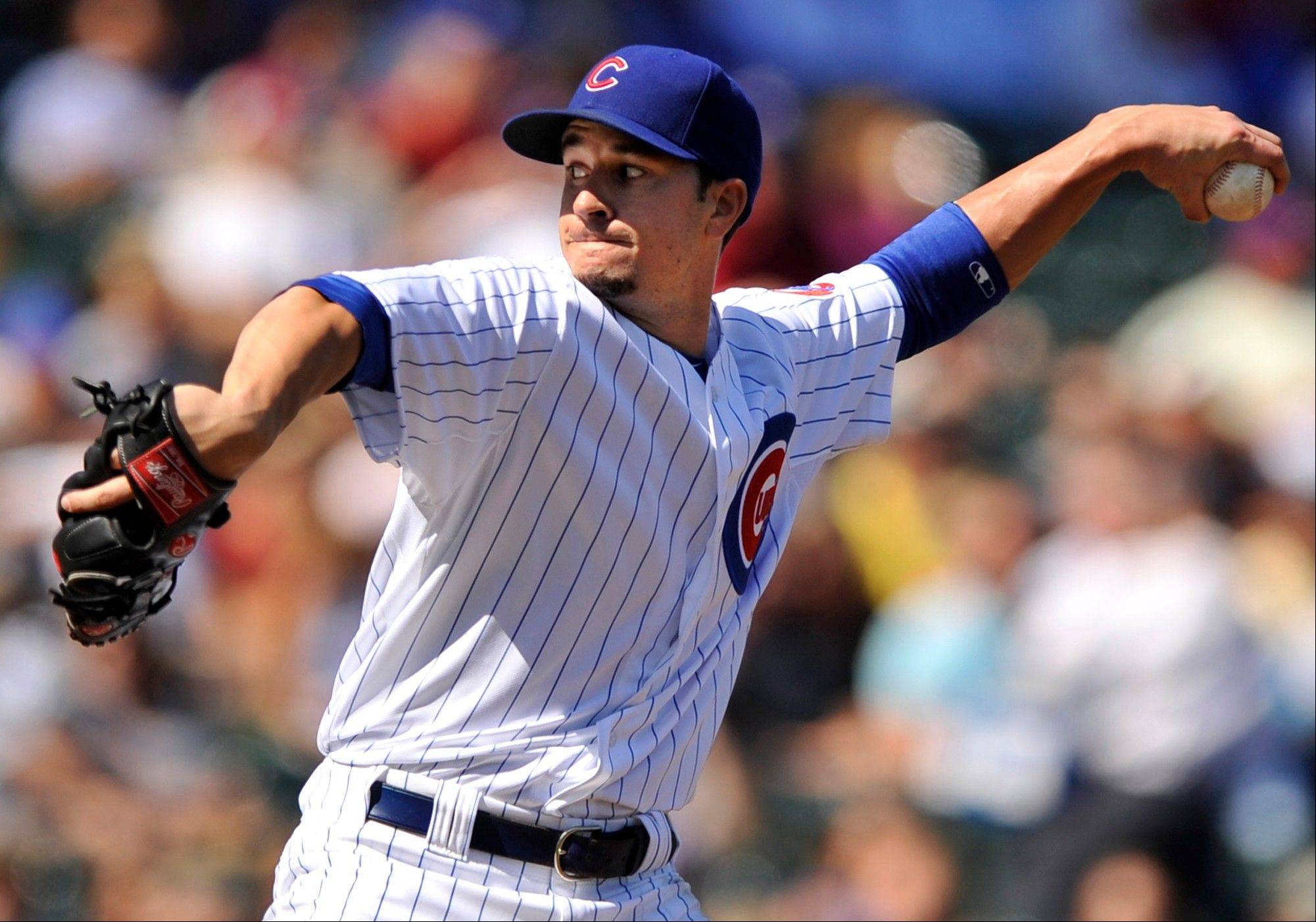 Cubs starter Chris Rusin delivers a pitch against the Pirates on Friday afternoon at Wrigley Field. Rusin worked 5 innings and earned his first major-league win as the Cubs beat the Pirates 7-4.