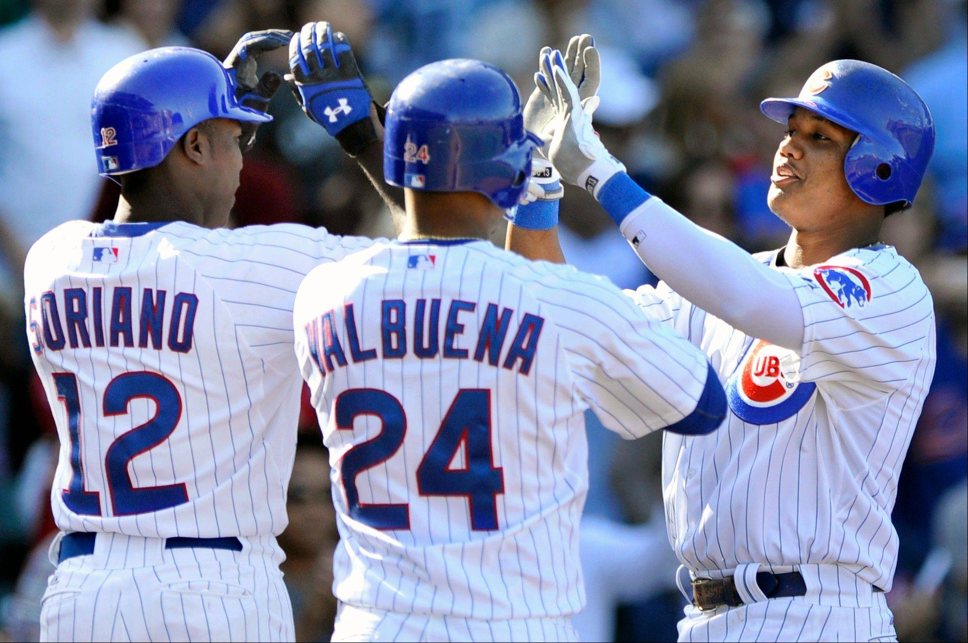 Starlin Castro celebrates with teammates Alfonso Soriano and Luis Valbuena after hitting a 3-run homer in the sixth inning Friday at Wrigley Field. The homer proved to be the difference maker as the Cubs topped the Pissburgh Pirated 7-4.