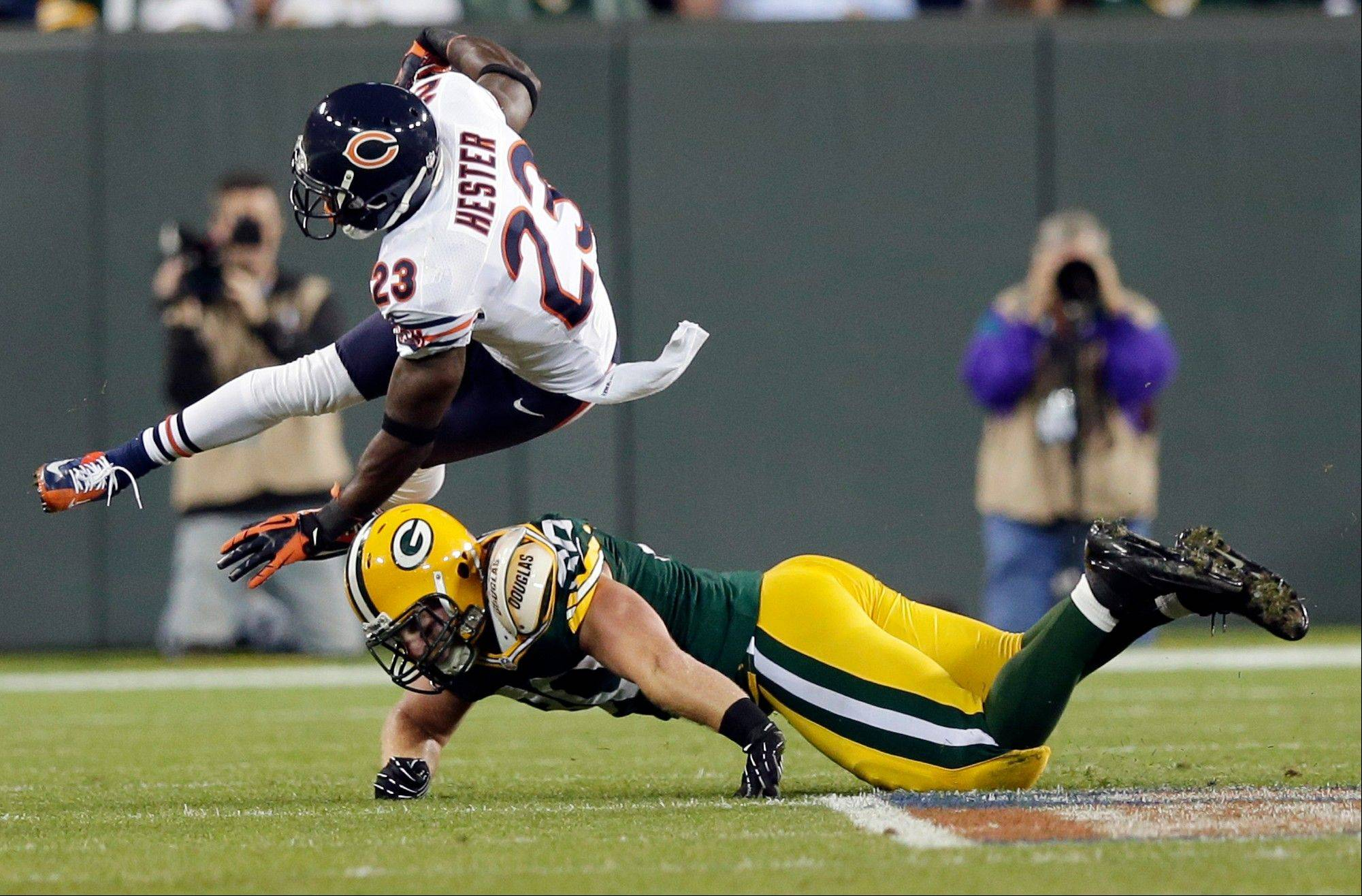 Chicago Bears' Devin Hester is tackled by Green Bay Packers' John Kuhn on a punt return during the second half.
