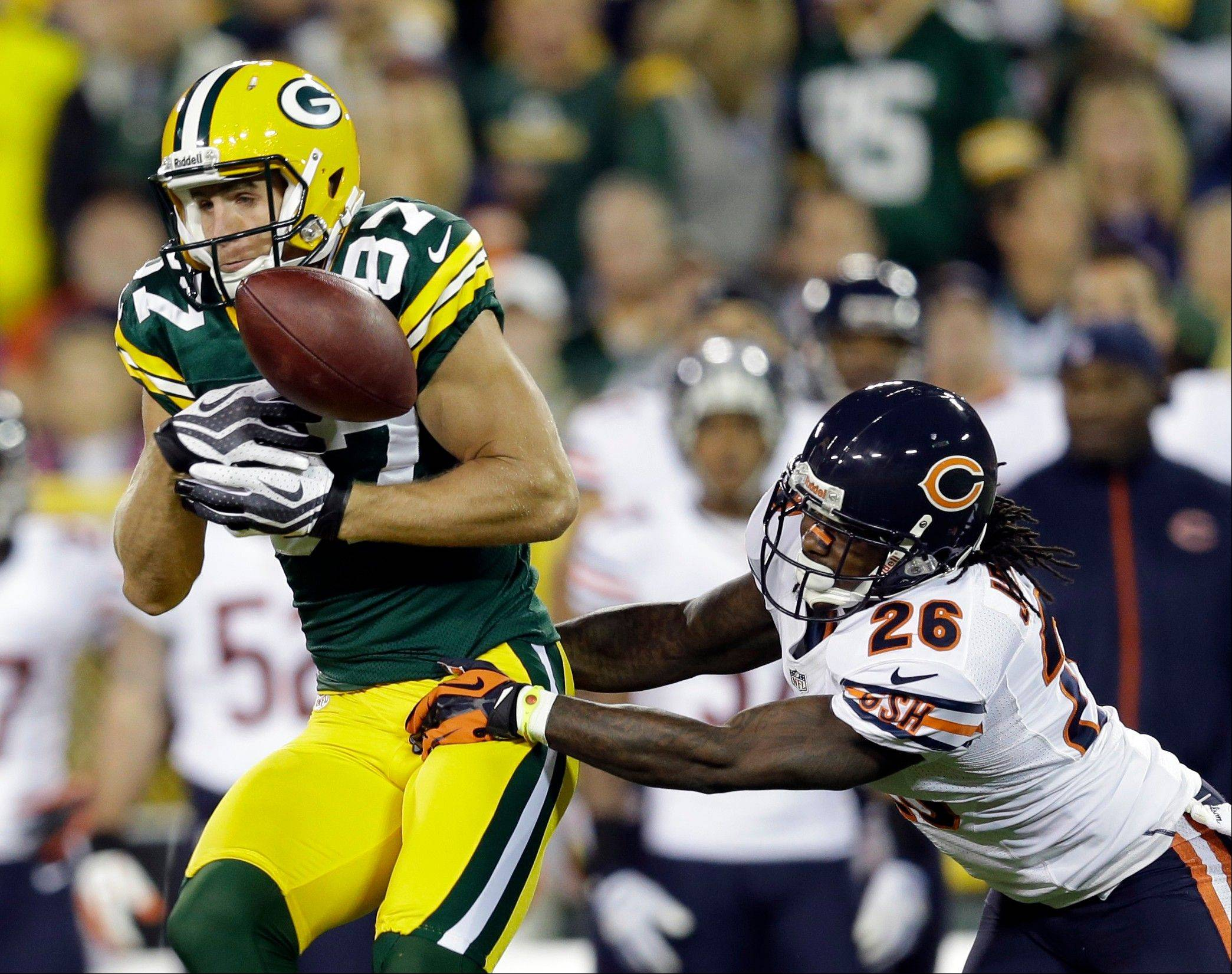Chicago Bears cornerback Tim Jennings breaks up a pass intended for Green Bay Packers wide receiver Jordy Nelson during the first half.