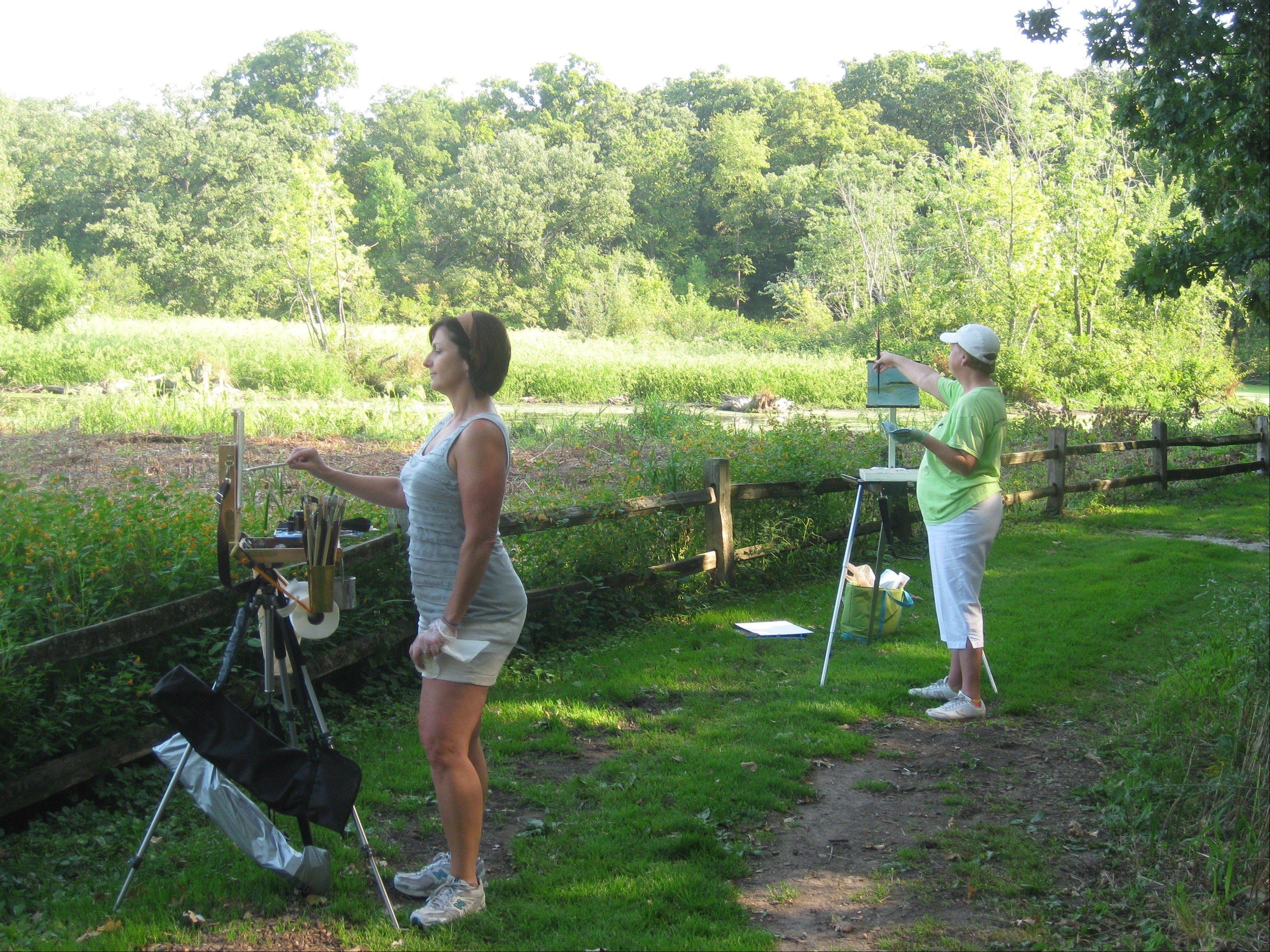 Artists paint at Crabtree Nature Center to get ready for Art in Nature Sept. 23.