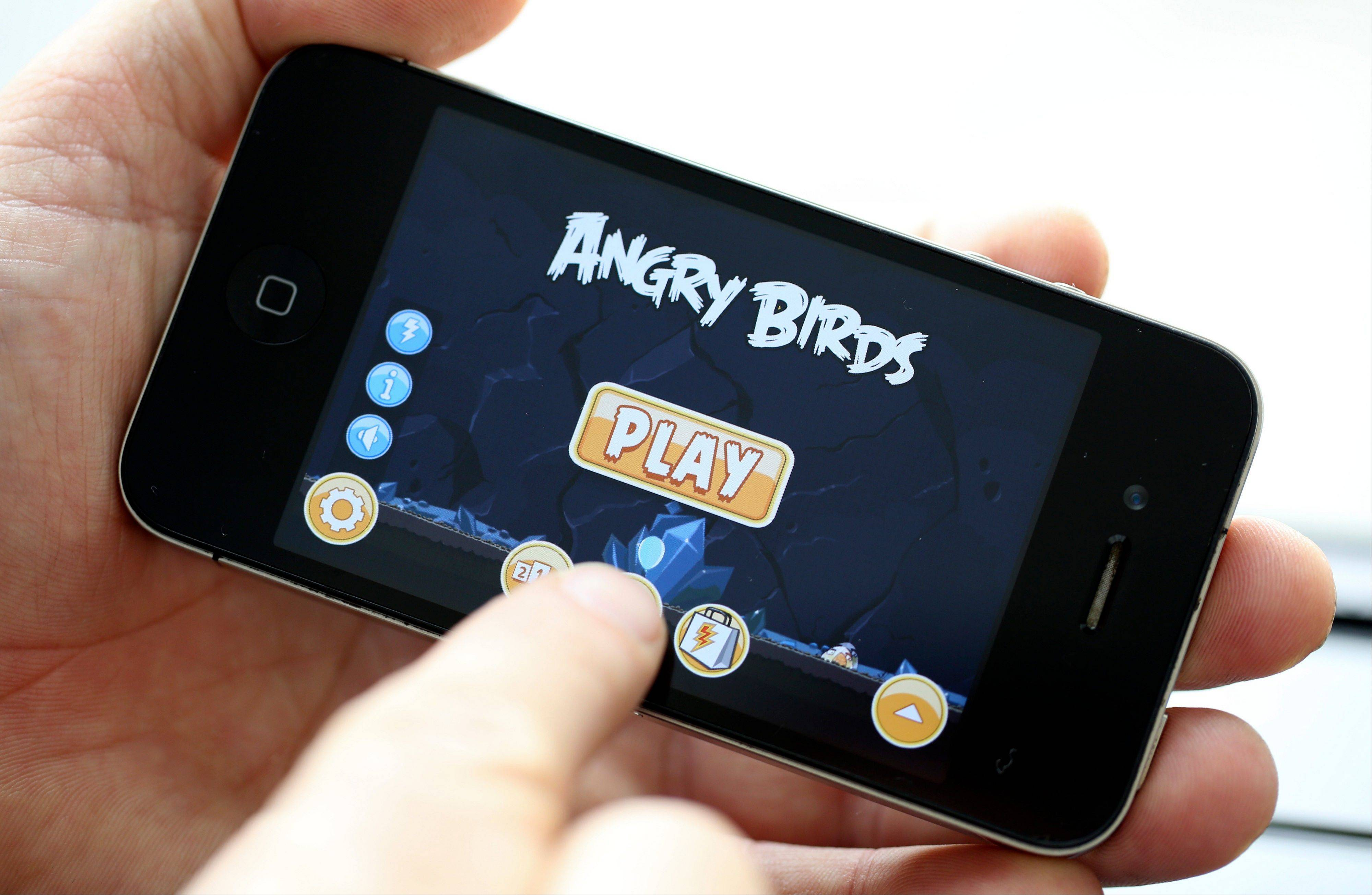 The ''Angry Birds'' mobile-phone game, designed by Rovio Mobile Oy is seen on an Apple Inc. iPhone 4 smartphone in this arranged photograph in London. Nokia and Motorola revealed new smartphones last week in hopes of generating interest before Apple announced its new iPhone Wednesday.