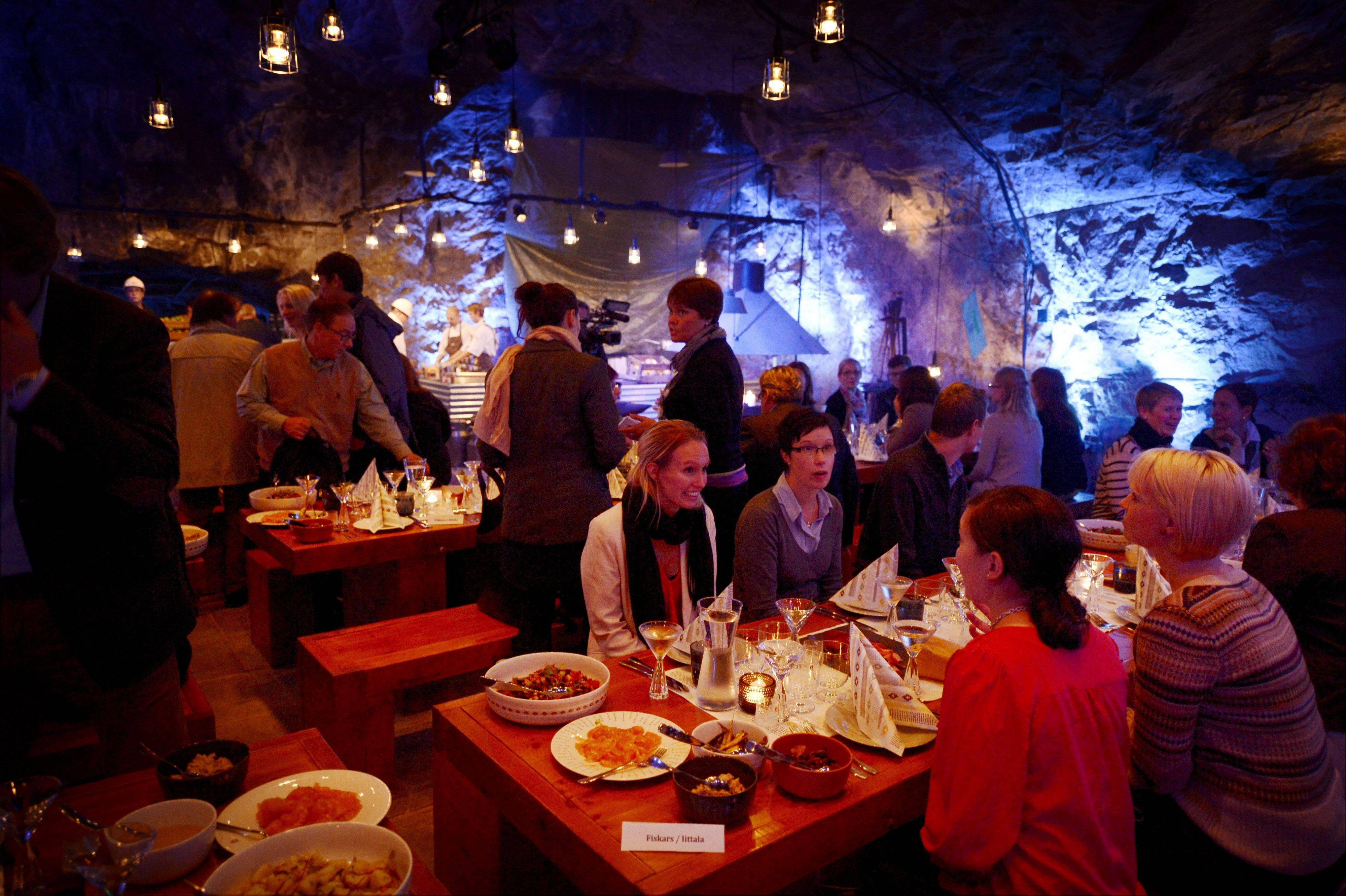 "Customers having dinner at Muru Pop Down restaurant at Tytyri mine in Lohja, Finland. The award-winning chef, Niklas Ekblom, is opening a new restaurant in Finland that turns the idea of ""pop-up"" eateries upside-down: it's located 80 meters (260 feet) underground."
