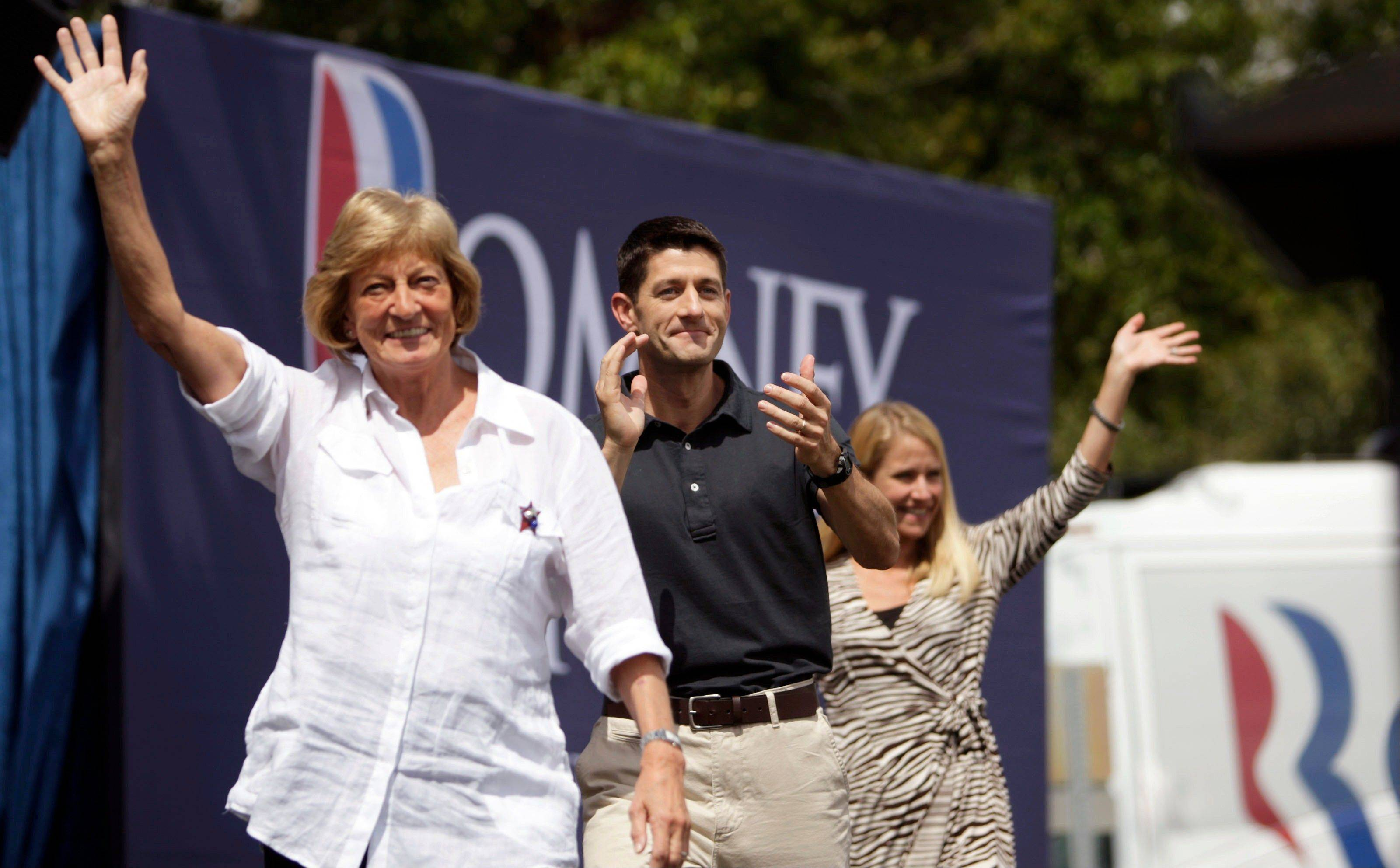 Flanked by his mother, Betty Douglas, left, and wife, Janna, right, U.S. Congressman Paul Ryan, the Republican nominee for vice president, takes the stage Saturday to speak to the crowd during a campaign stop in Oldsmar, Fla.