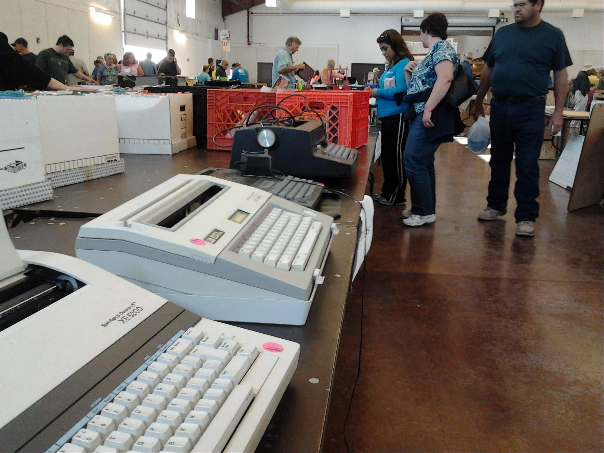 Typewriters from IBM and Smith-Corona were going for $1 at the St. Peter Barn Sale on Saturday at the Kane County Fairgrounds in St. Charles. The sale ends at 2 p.m. Sunday.