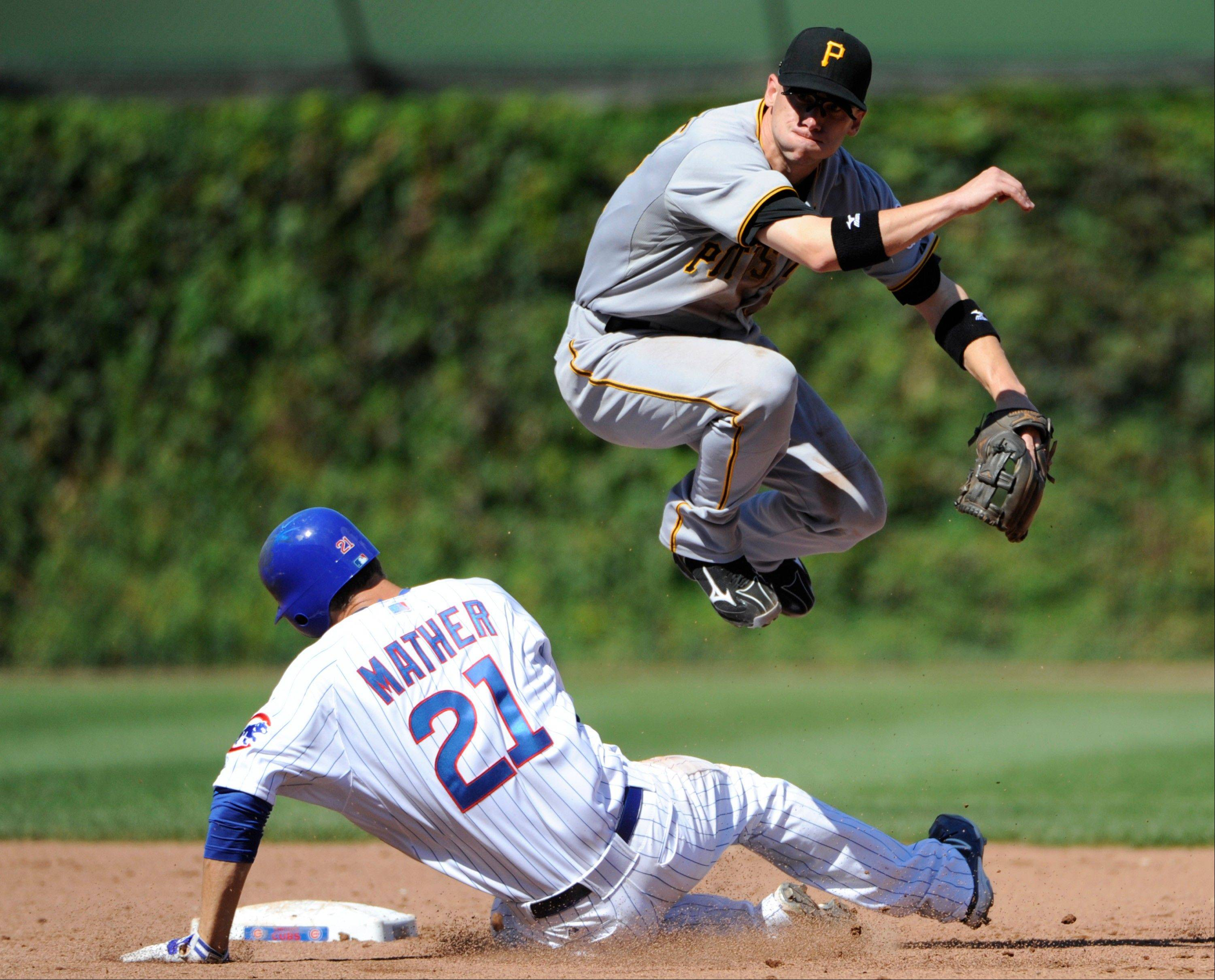 Pittsburgh Pirates shortstop Clint Barmes, top, forces out Chicago Cubs' Joe Mather left, at second base during the fifth inning of a baseball game, Saturday, Sept. 15, 2012 in Chicago. The Cubs' Darwin Barney was safe at first. (AP Photo/David Banks)
