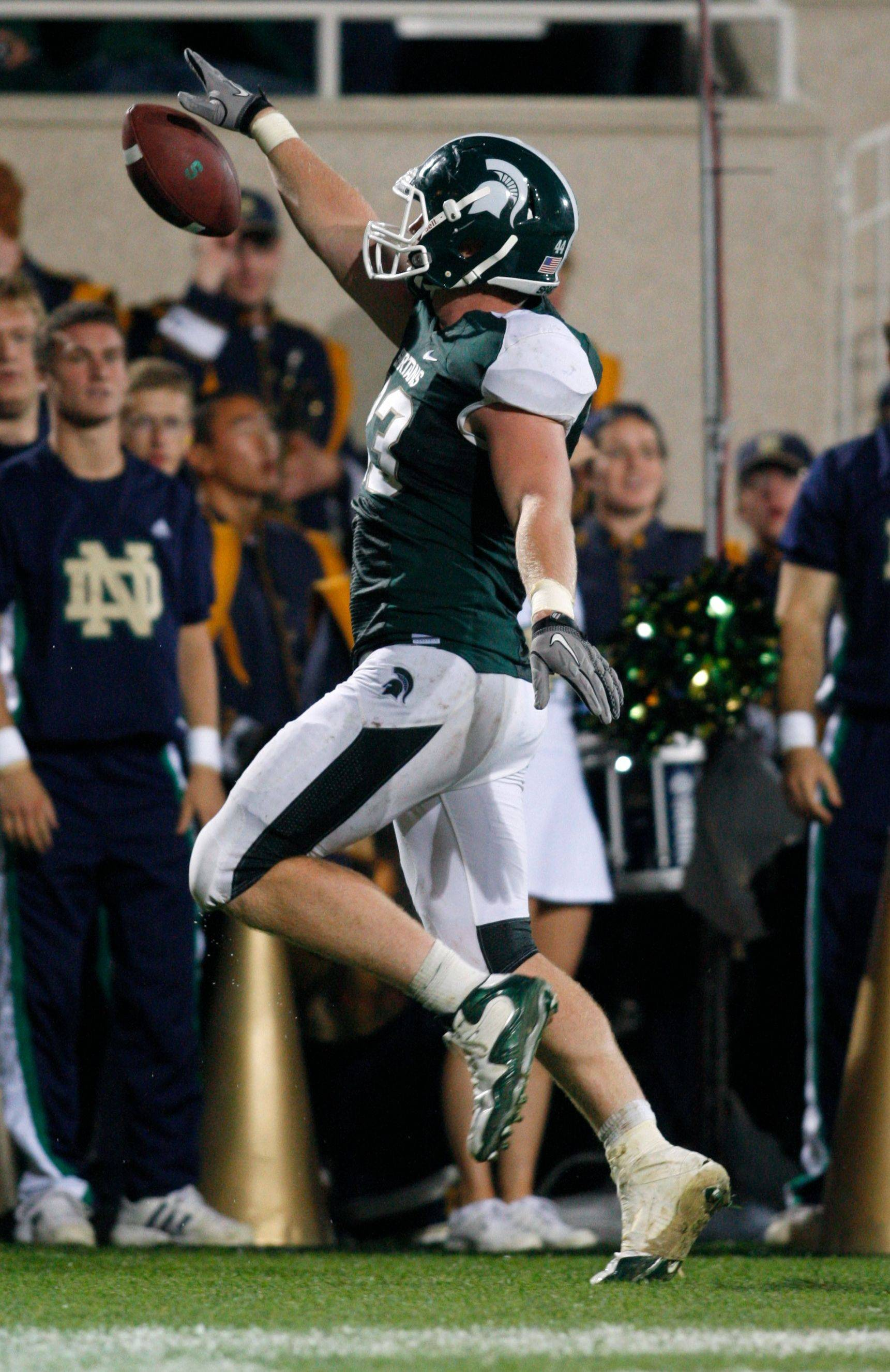 Michigan State tight end Charlie Gantt celebrates as he scores the game-winning touchdown on a 29-yard pass reception off a fake field goal during the Spartans' victory over Notre Dame in 2010.