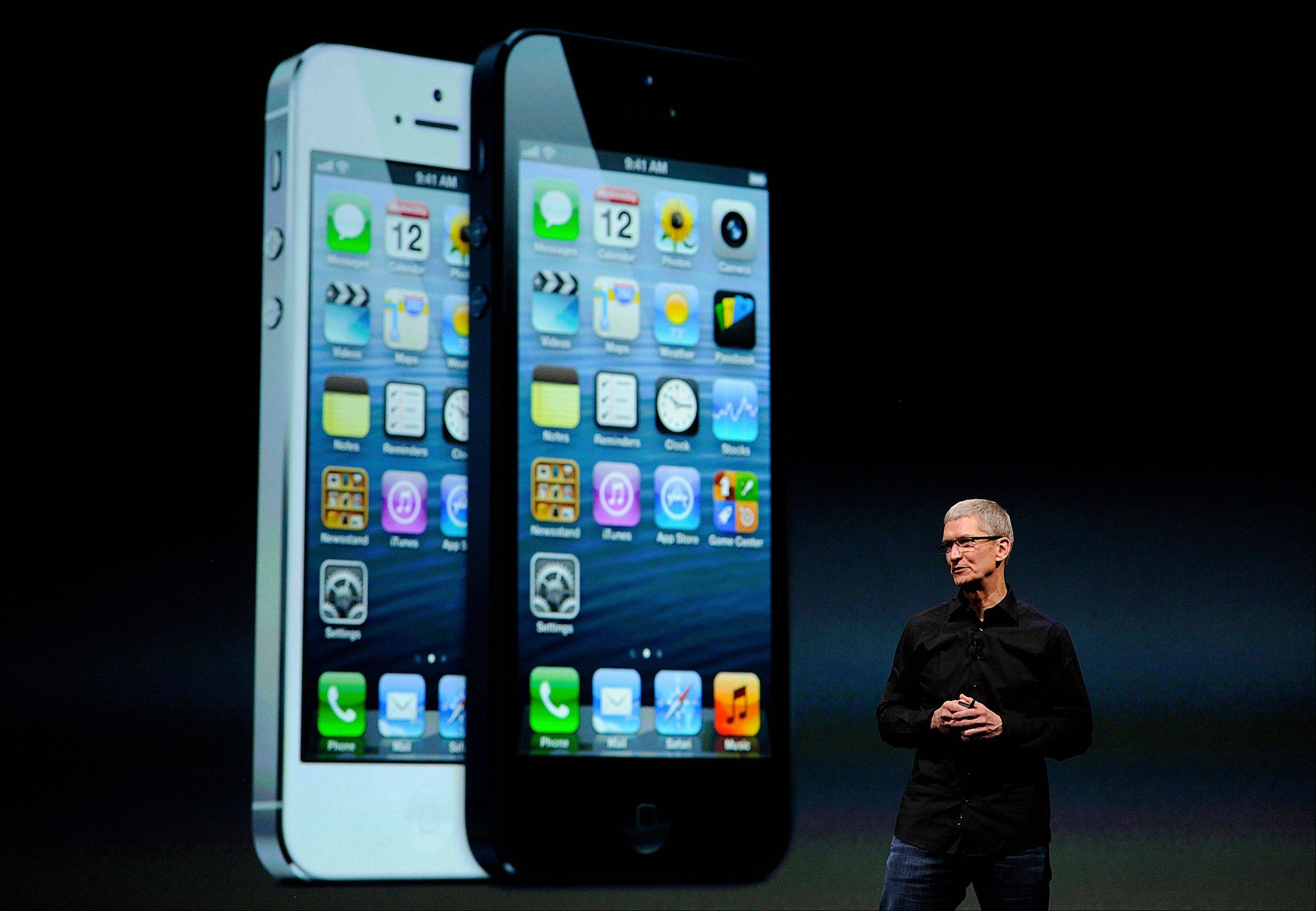 Tim Cook, chief executive officer of Apple Inc., speaks Wednesday during an event in San Francisco, California, U.S. Apple Inc. unveiled the iPhone 5 in an overhaul aimed at widening its lead over Samsung Electronics Co. and Google Inc. in the $219.1 billion smartphone market.