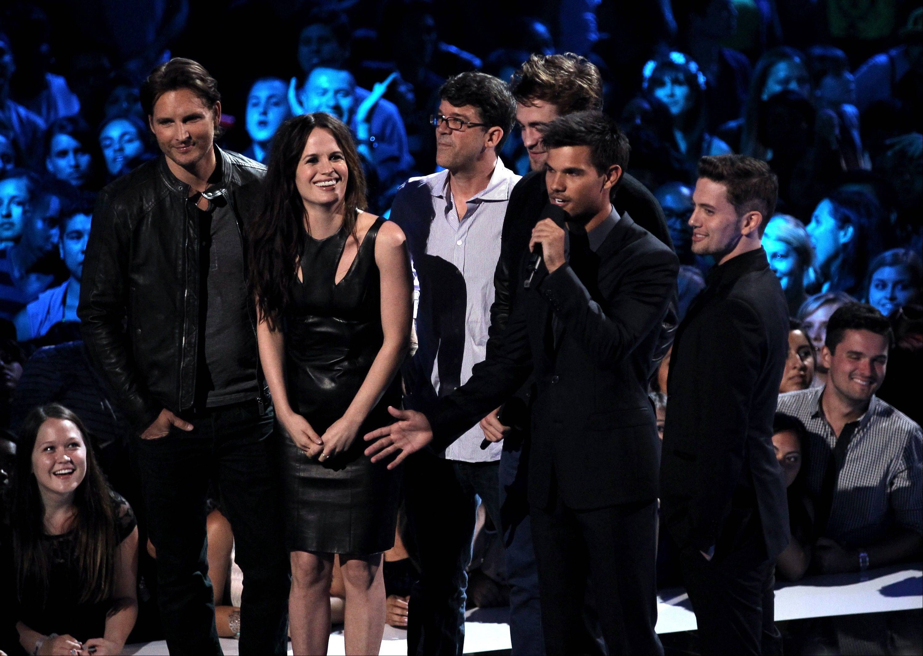 From left, Peter Facinelli, Elizabeth Reaser, Wyck Godfrey, Robert Pattinson, Taylor Lautner and Jackson Rathbone speak onstage at the MTV Video Music Awards on Thursday, Sept. 6, 2012, in Los Angeles.