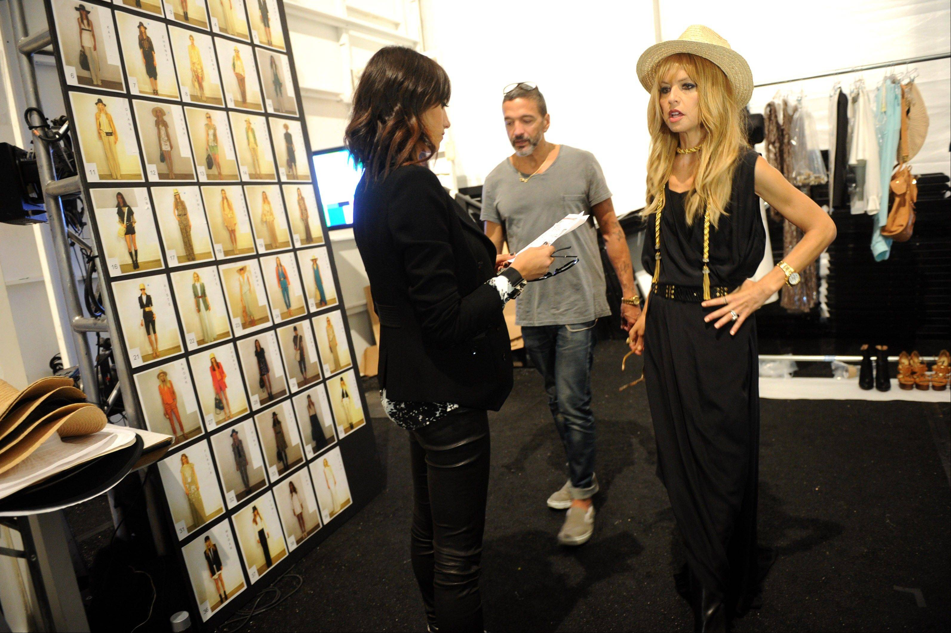 Designer Rachel Zoe, right, is seen backstage before her spring 2013 collection is shown at Fashion Week, Wednesday, Sept. 12, 2012, in New York.