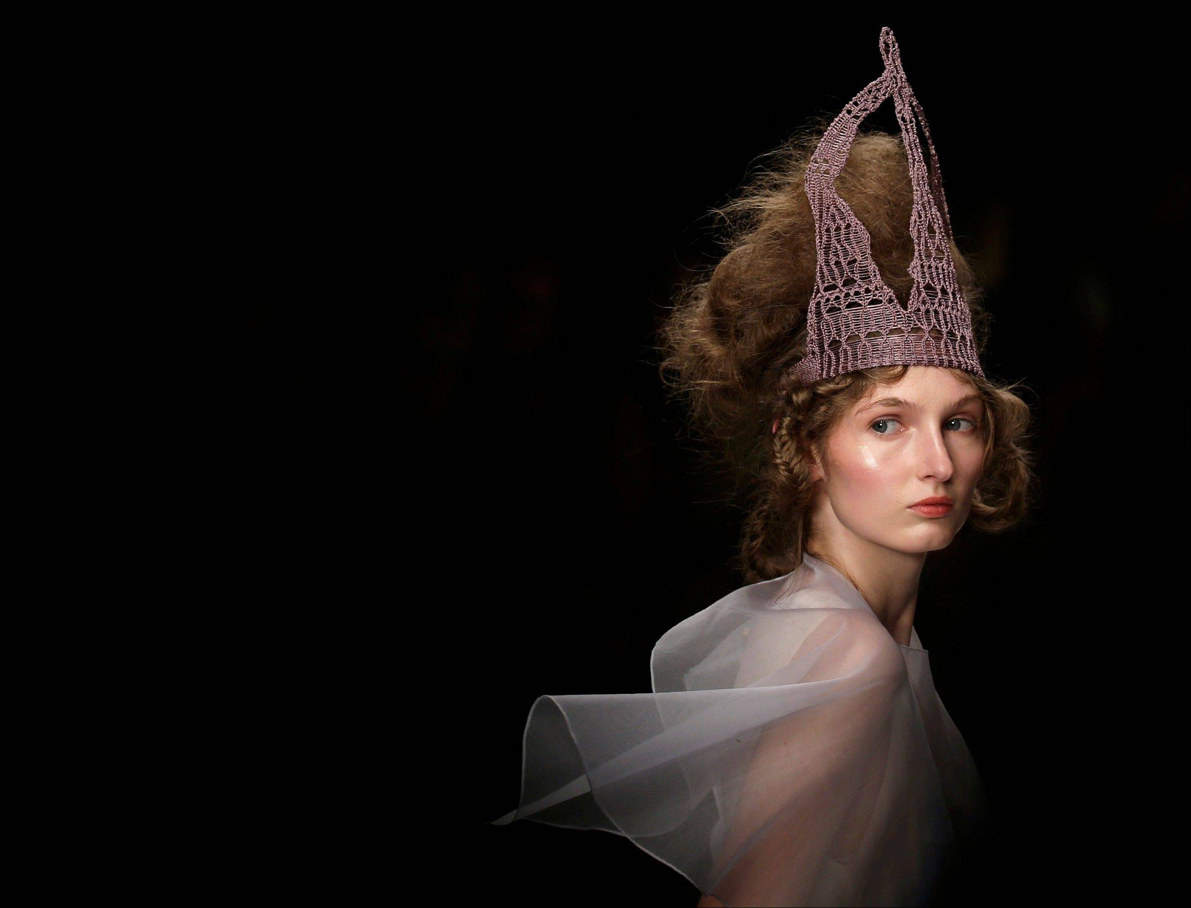 A model presents a design by Bora Aksu during his Spring/Summer 2013 show at London Fashion Week in London, Friday, Sept. 14, 2012.