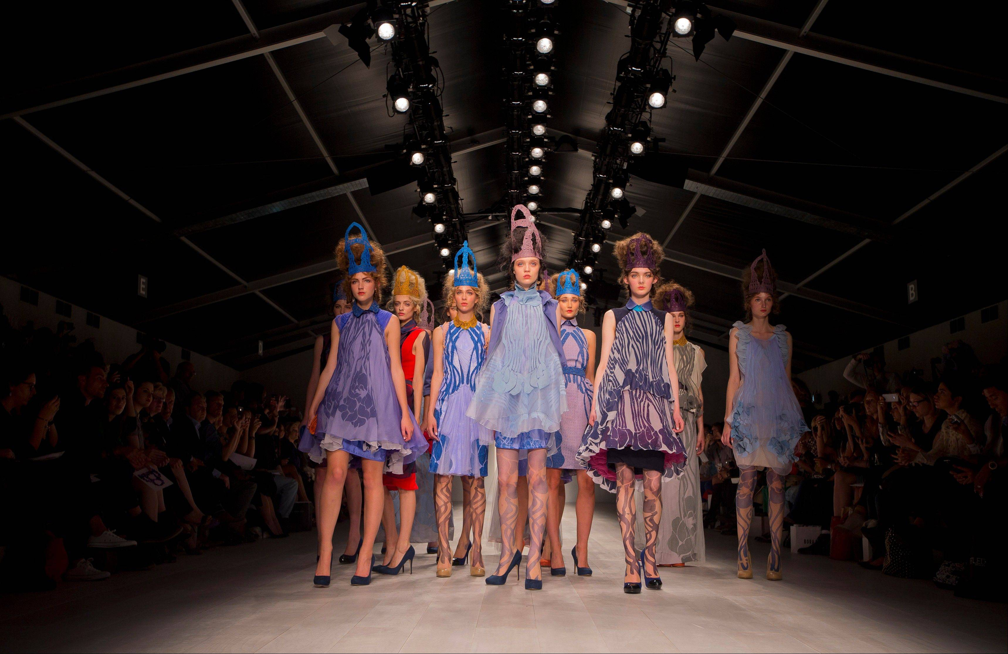 Models wear designs from the Bora Aksu Spring/Summer 2013 collection during London Fashion Week, Friday, Sept. 14, 2012.