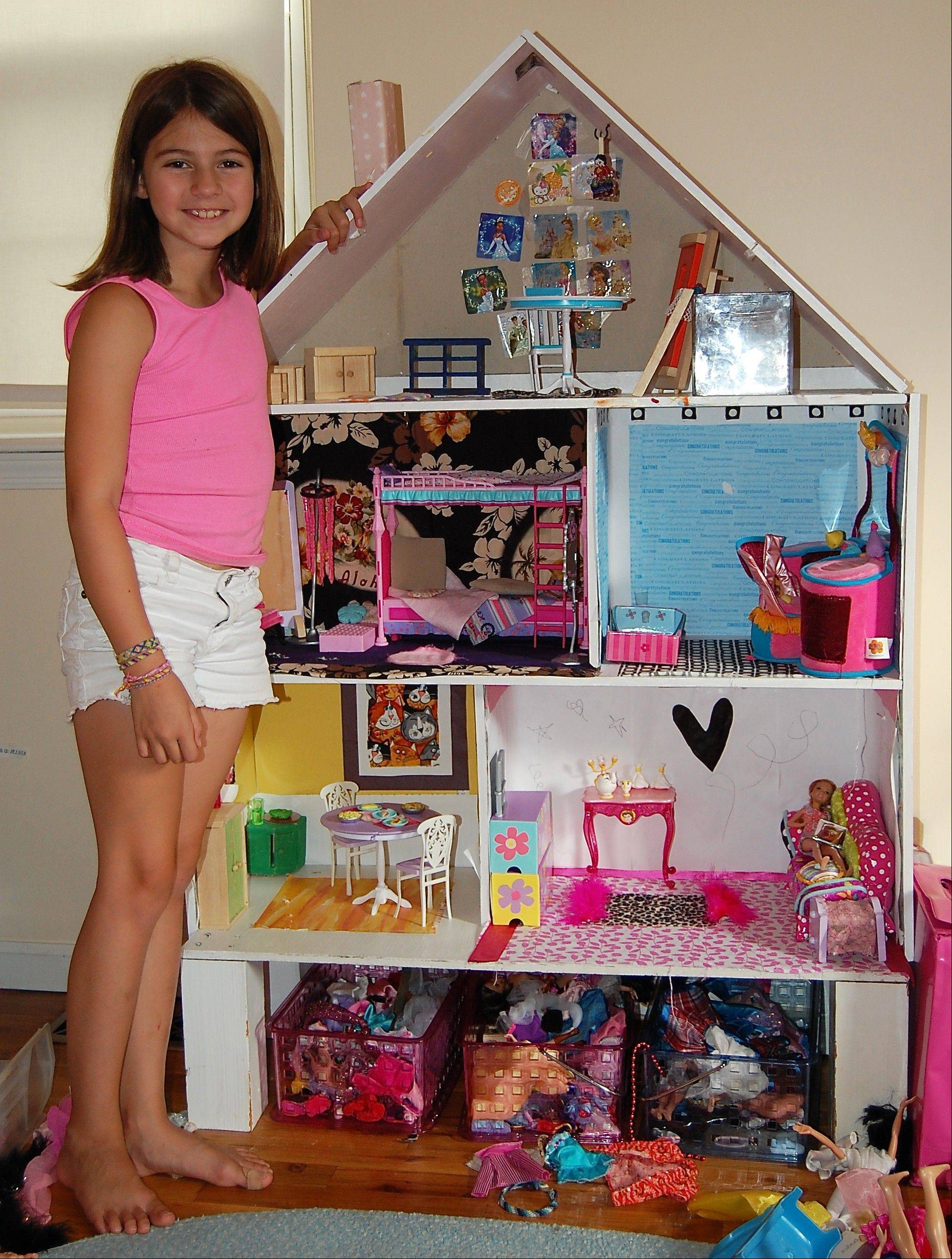 "Laura Jofre and her daughter, shown here, enjoy the time they spend collaborating on the child's dollhouse, currently an eclectic collection of Barbie furniture, painted wood furniture, fabric floors and ""doodle wall."""
