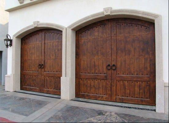 Arched openings and custom-made garage doors are popular in larger homes.