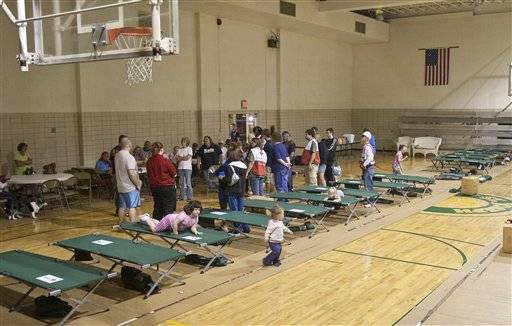 Mishawaka, Ind., residents receive instructions at a Red Cross emergency shelter on Sept. 14 at the St. Joseph's School in Mishawaka. Police and firefighters evacuated a large area of Mishawaka after a reported chemical fire at an abandoned factory.