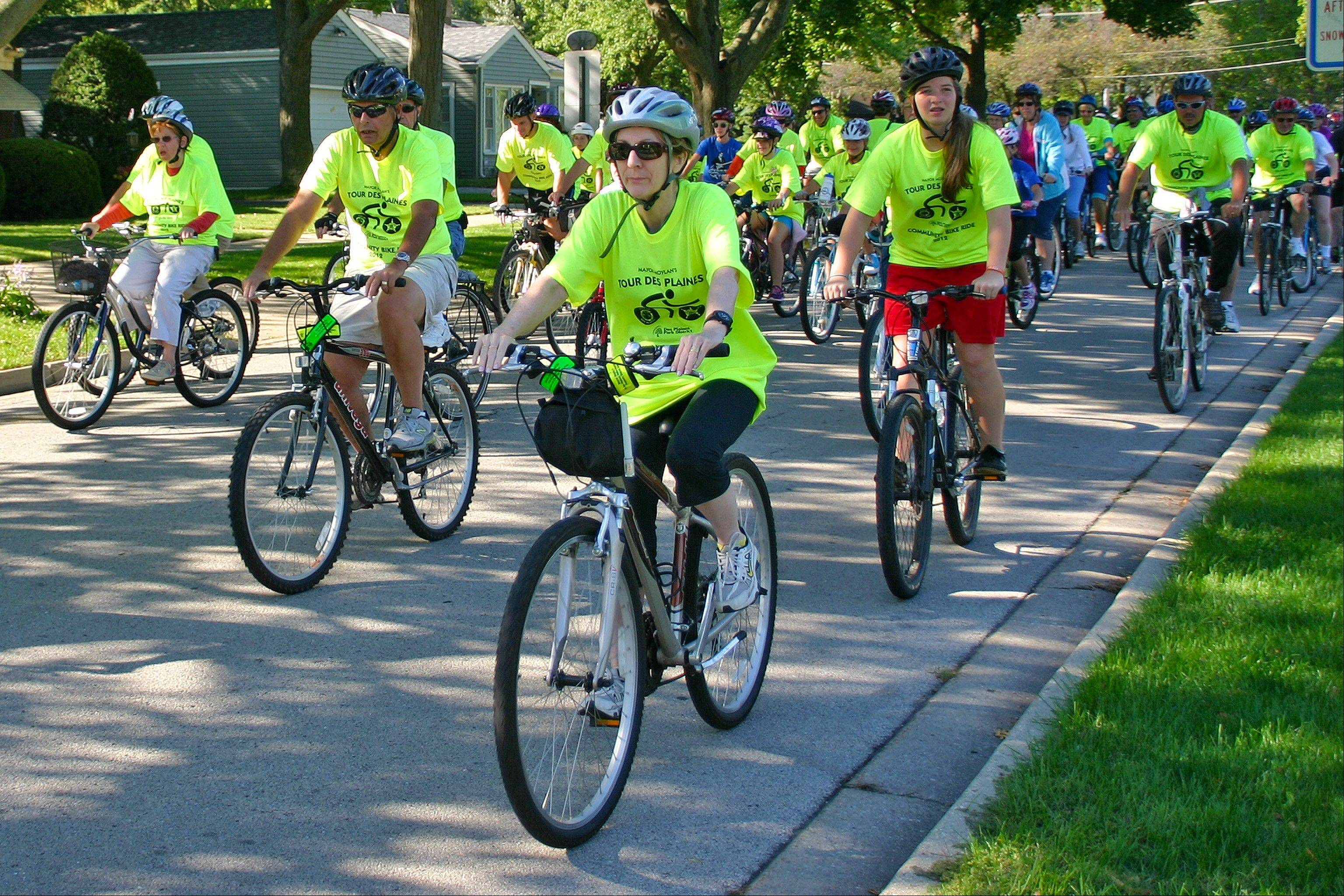 The annual Tour Des Plaines Bike Ride, which drew about 300 participants Saturday morning, leaves West Park, the first rest stop on the ride. The Tour is nine miles, ending with a beautiful ride up the bike trail around Lake Opeka on its return to the starting point at the Lake Park Clubhouse.