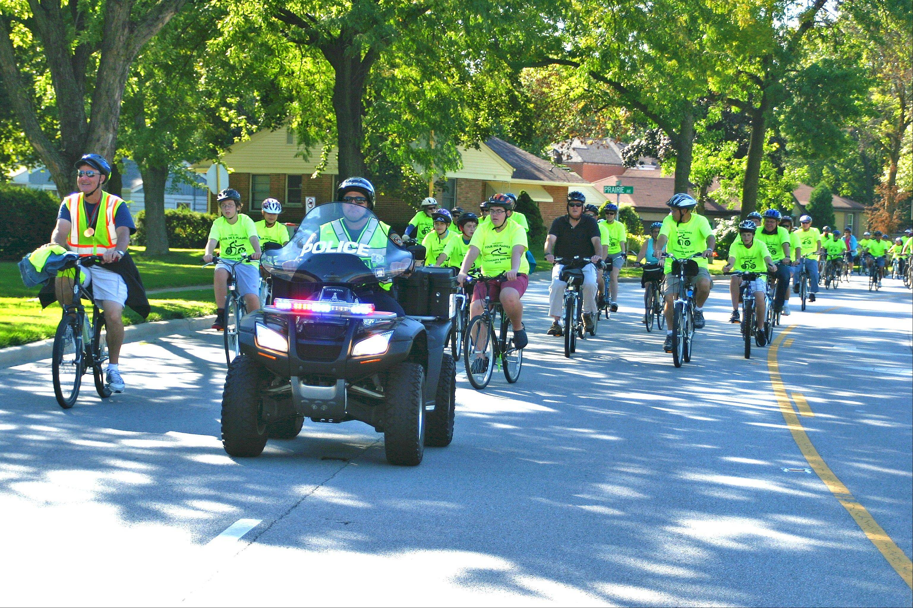 The annual Tour Des Plaines Bike Ride, which drew about 300 participants Saturday morning, makes its way north on Wolf Road towards its first rest stop at West Park. The Tour is nine miles, ending with a beautiful ride up the bike trail around Lake Opeka.