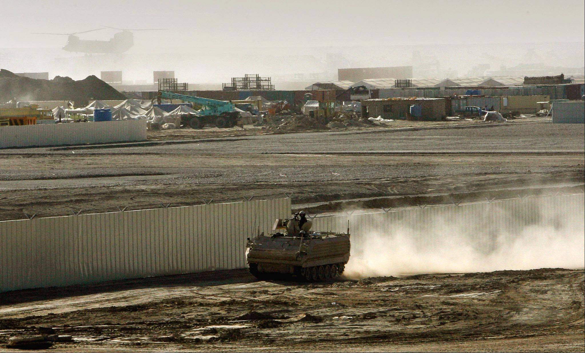 Associated Press/ Jan. 10, 2007 A British armored vehicle patrols on the periphery of the camp Bastion in southern Afghanistan.