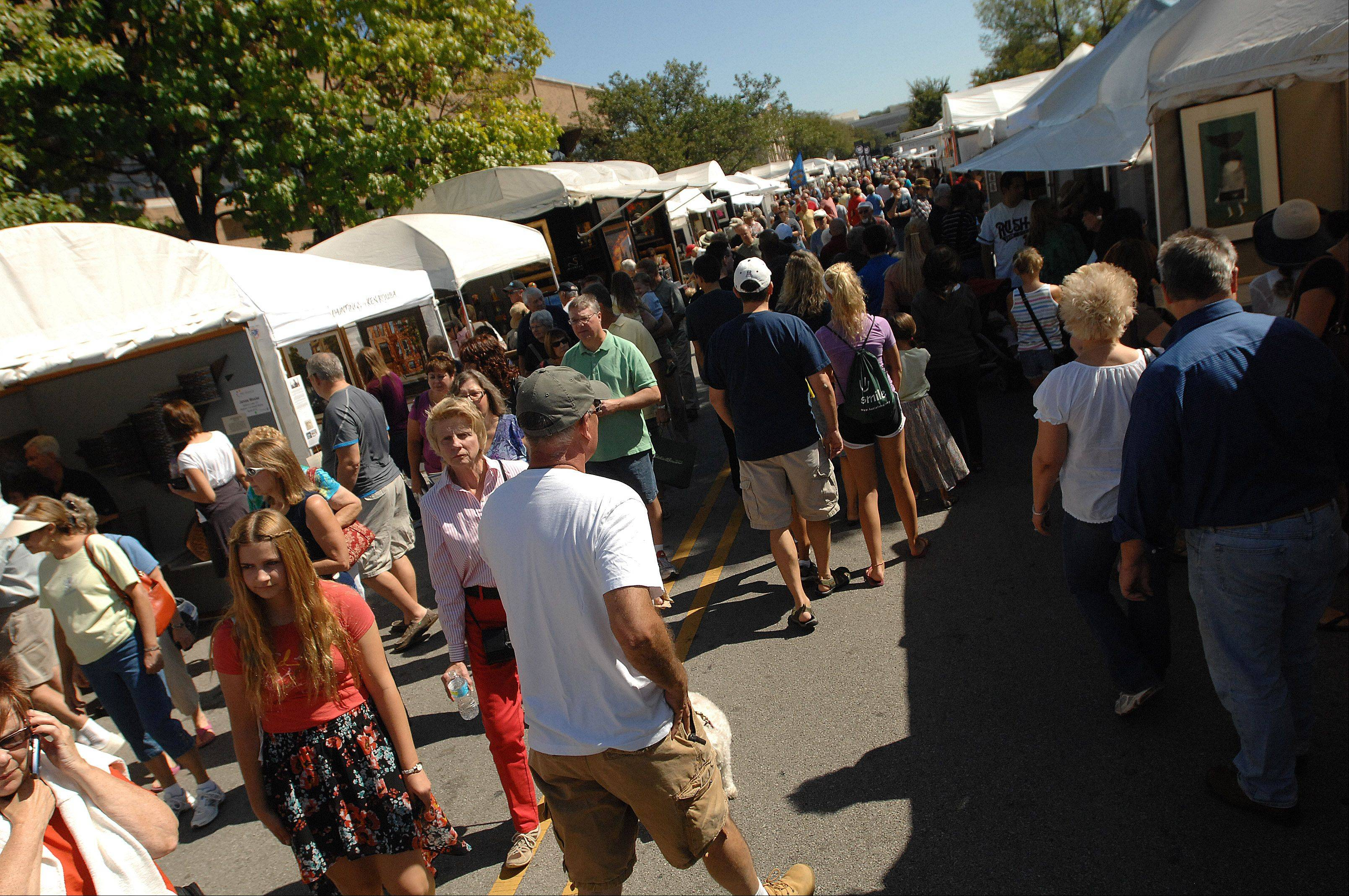 The 27th annual Naperville Fine Art Fair features about 140 booths displaying paintings, pottery, jewelry, photography and other forms of art. The event continues from 10 a.m. to 5 p.m. Sunday in downtown Naperville.