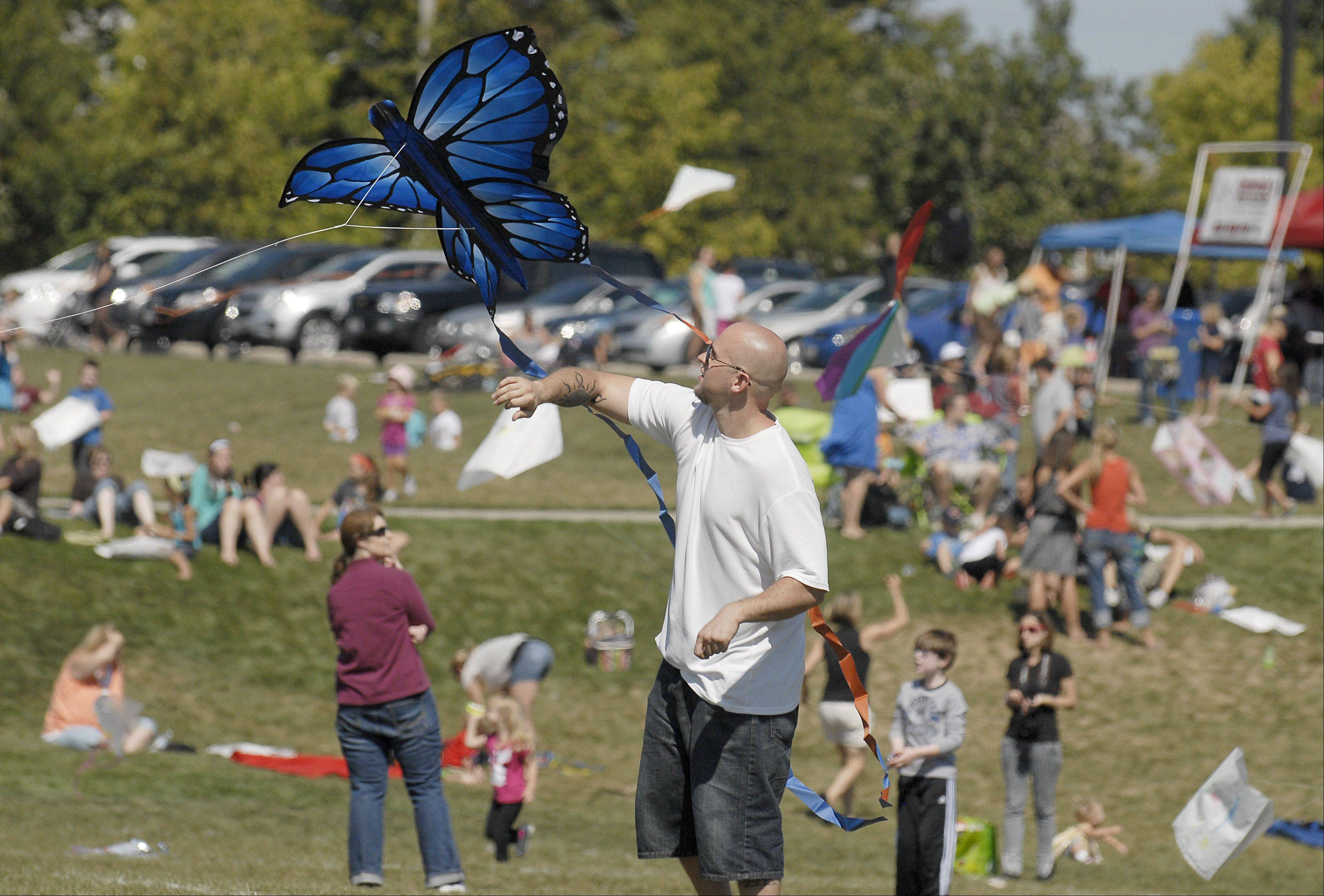 Parents and children dot the landscape as they attempt to get their kites airborne on Saturday during the Geneva Park District's annual Kite Festival at Peck Farm Park.