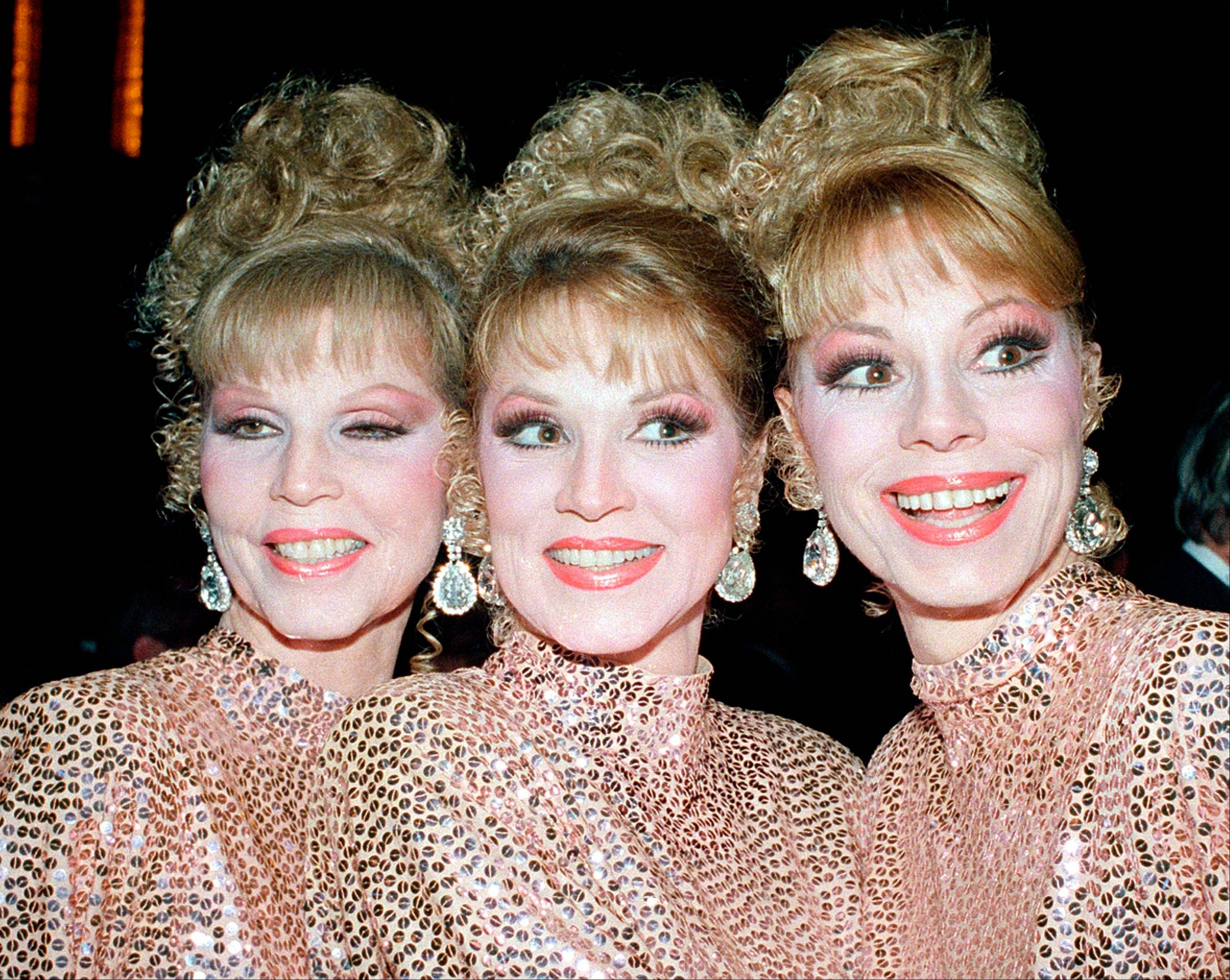 The McGuire Sisters, from left, Christine, Phyllis and Dorothy, pose outside Radio City Music Hall in New York.