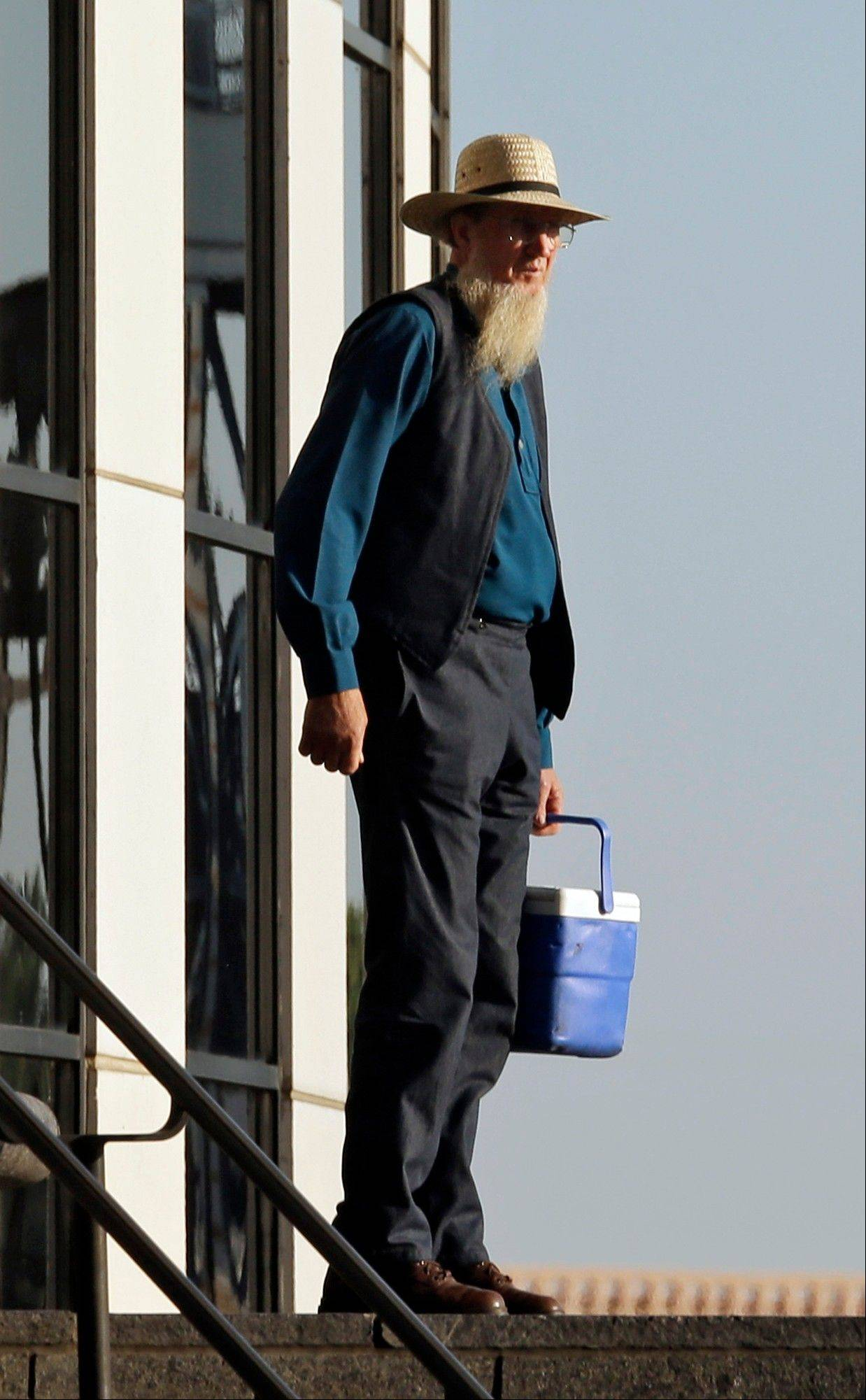 An Amish man leaves the United States Court House in Cleveland Wednesday.