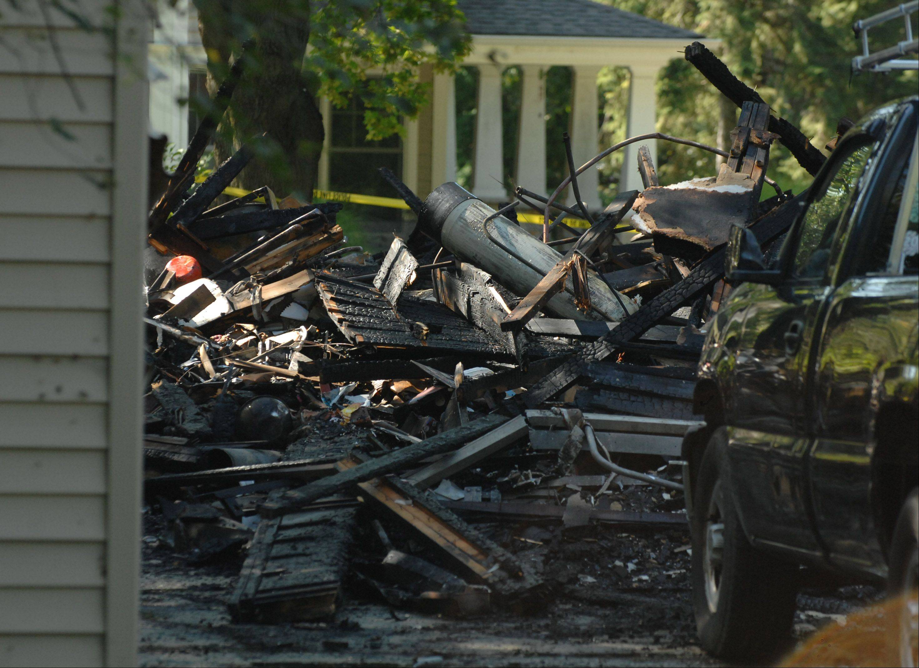 A two-story, single-family house in Warrenville was reduced to rubble after a blaze broke out there about 5 a.m. Saturday, severely burning 33-year-old Will Lowe.