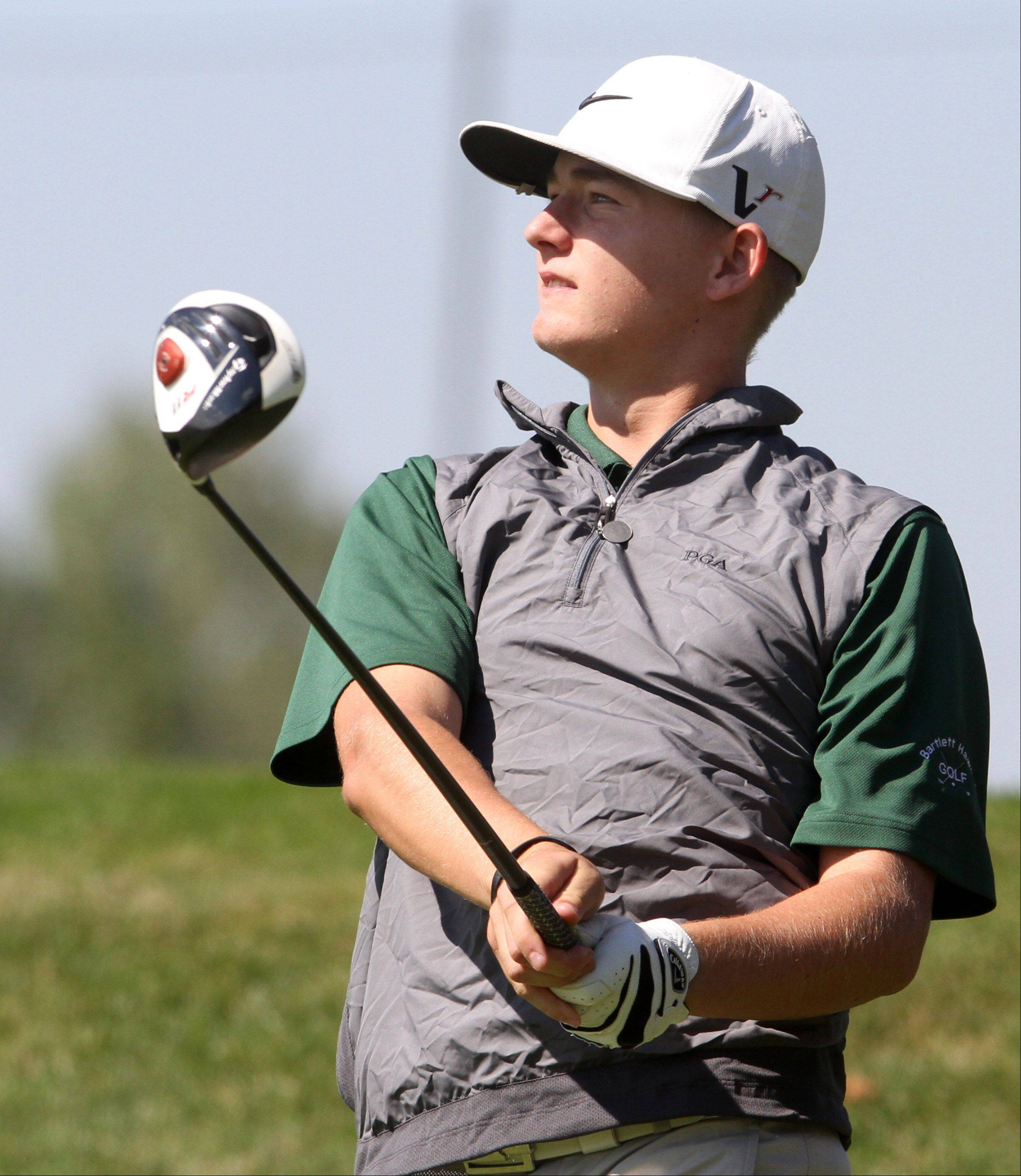 Bartlett's Ryan Wolfe watches his ball on No. 5 during the Charger Classic boys golf invite, hosted by Dundee-Crown High School, at Randall Oaks Golf Club in West Dundee on Saturday.